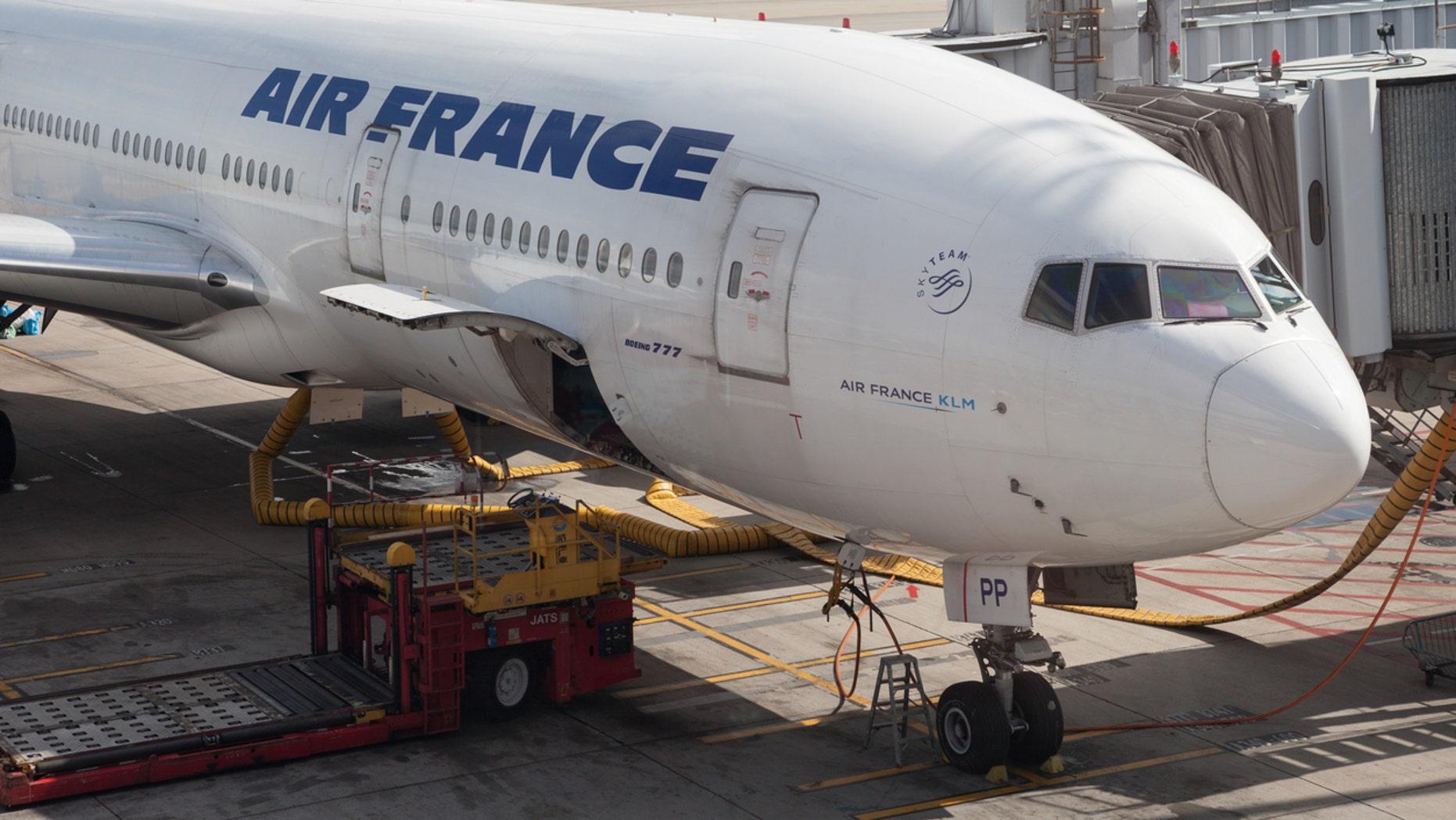 """Hong Kong, China - July 9, 2012: Air France Boeing 777 passenger plane parked at the Hong Kong International Airport in Hong Kong, China. Air France is one of the world's largest airlines."""