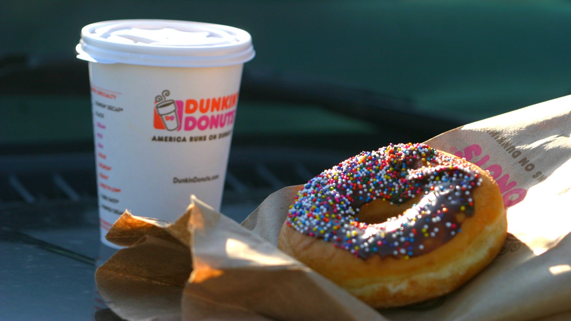 Brooklyn, New York, USA - April 12, 2014: A Dunkin Donuts coffee and doughnut.