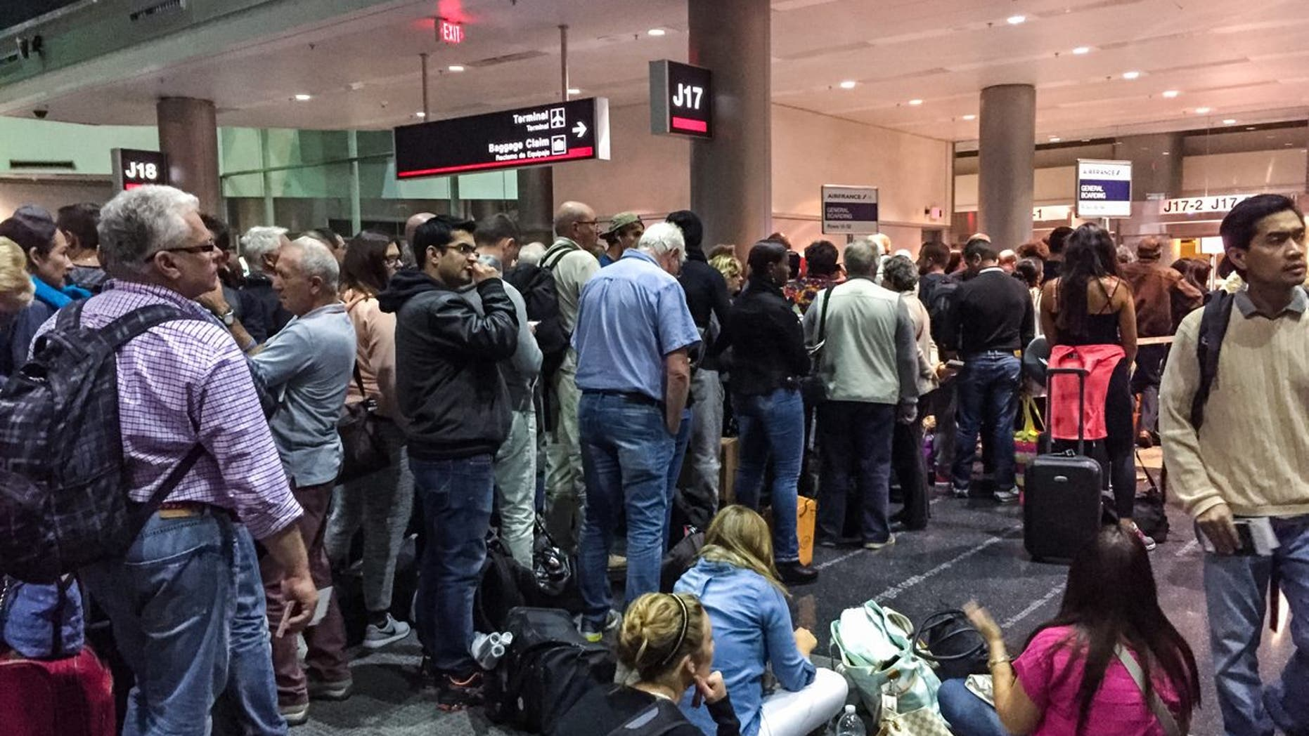 Miami, USA  - January 30, 2015: Passengers waiting at the gate for boarding on Air France flight to Paris, Miami Airport