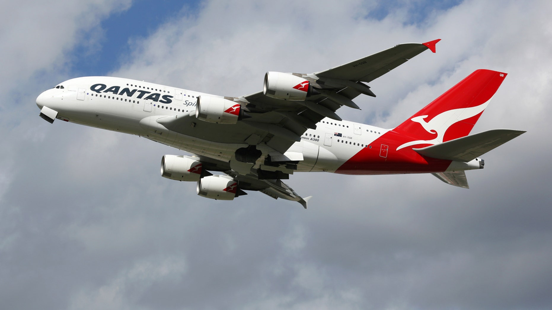 London Heathrow, United Kingdom - August 28, 2015: A Qantas Airways Airbus A380 with the registration VH-OQB taking off from London Heathrow Airport (LHR) in the United Kingdom. The Airbus A380 is the world's largest passenger airliner. Qantas is the flag carrier airline of Australia.