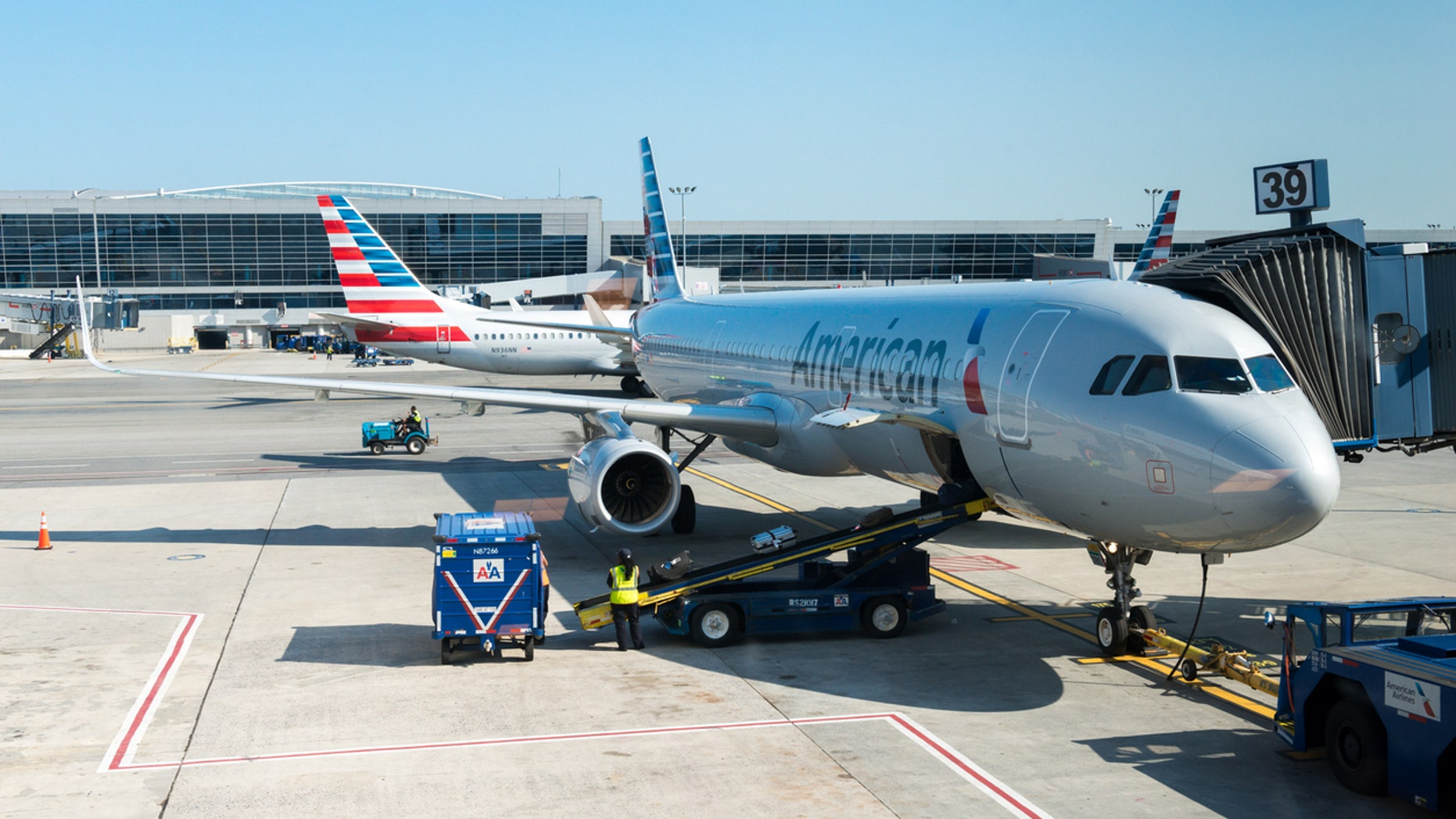 Six American Airlines crew members were transported to a local hospital after requesting medical evaluations, the airline said.