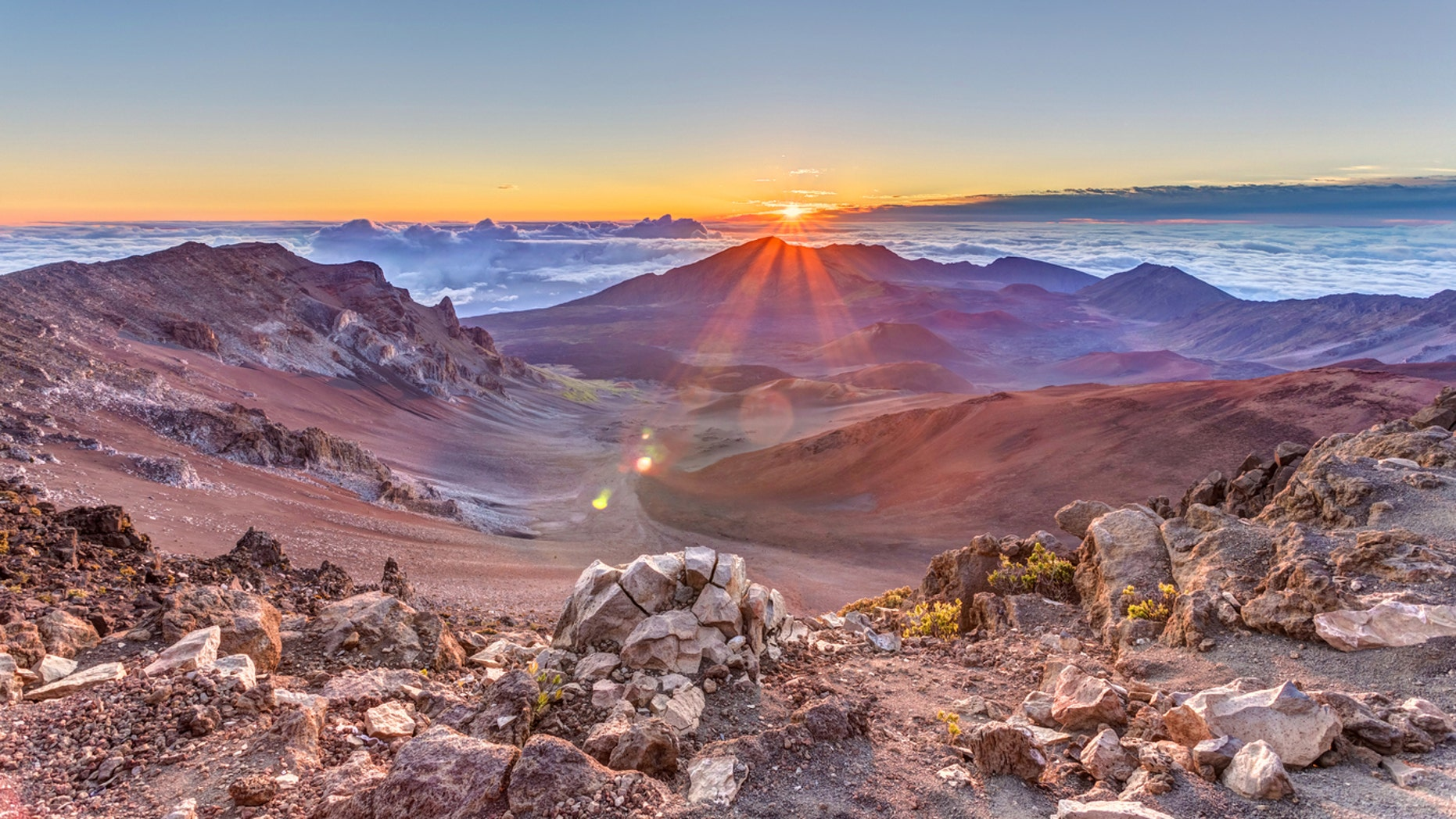 Sunrise from the summit of Haleakala volcano on the tropical island of Maui, Hawaii.