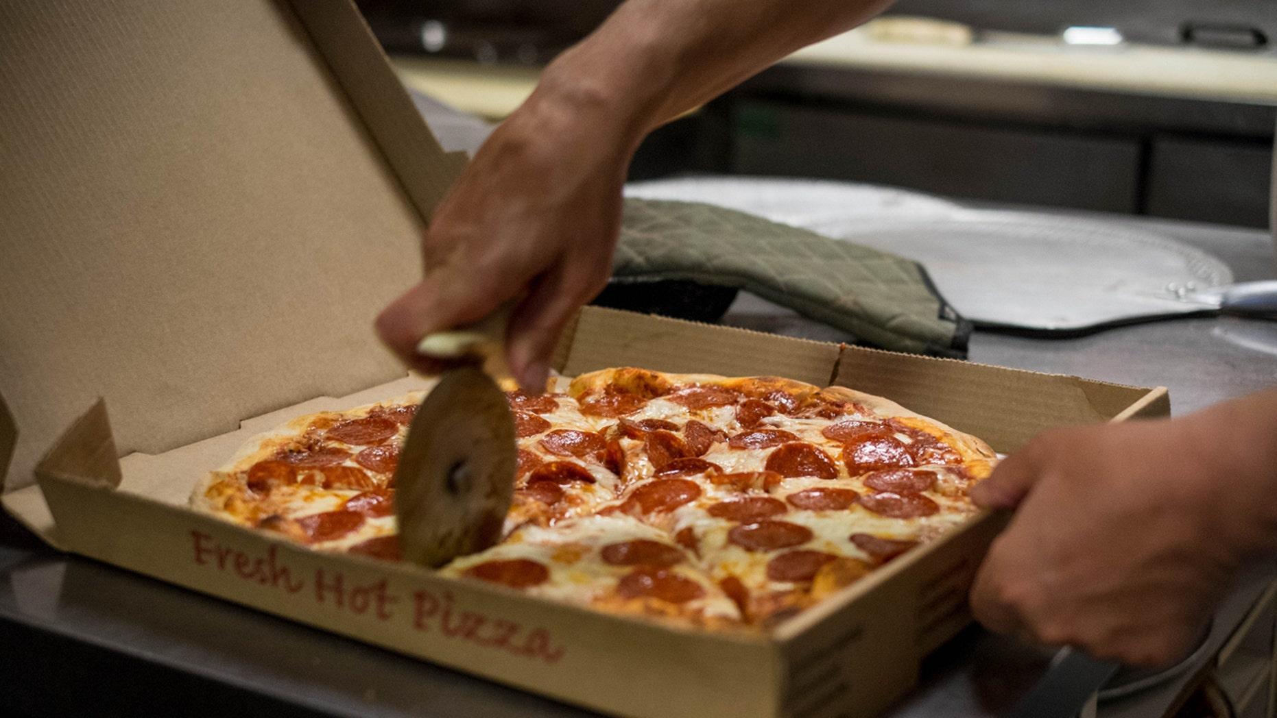A pizzeria is under fire for alleged anti-cop slurs.