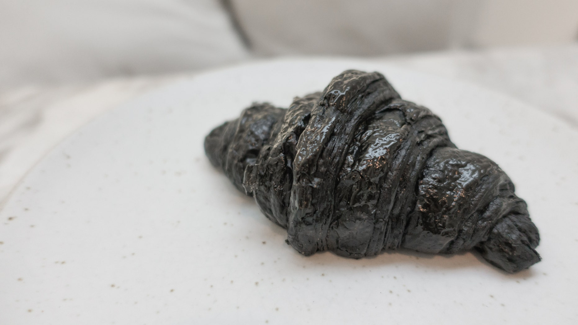A cafe in London has debuted an activated charcoal vegan croissant that has some people losing their appetites.