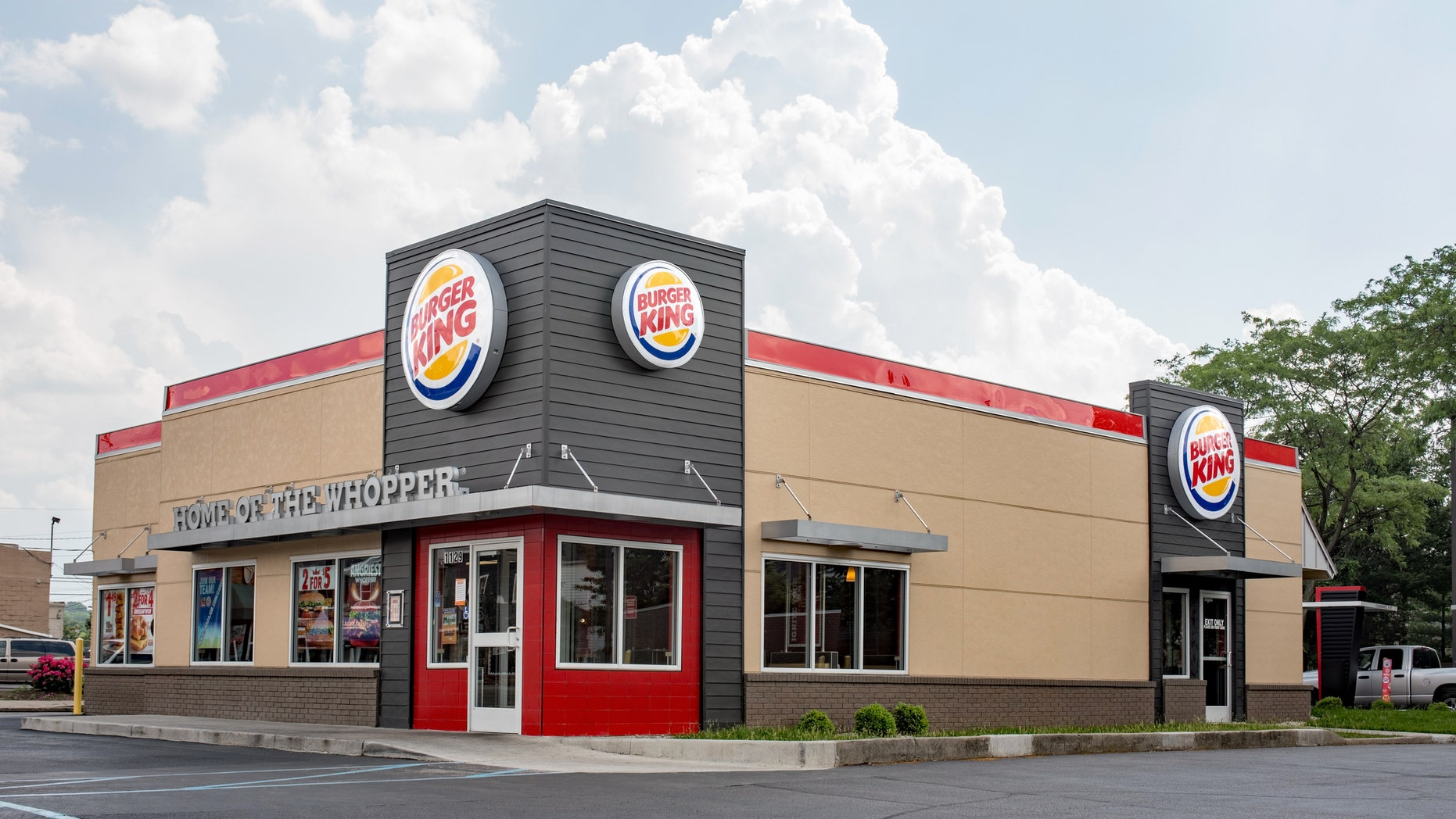 """Dayton, Ohio, USA - May 29, 2016: The newest Burger King """"20/20"""" restaurant design with a sleek, contemporary, futuristic industrial-look theme includes brick cladding, manicured landscaping and a covered drive-thru order point with digital order screens. The new design was first introduced in USA in April 1, 2010."""