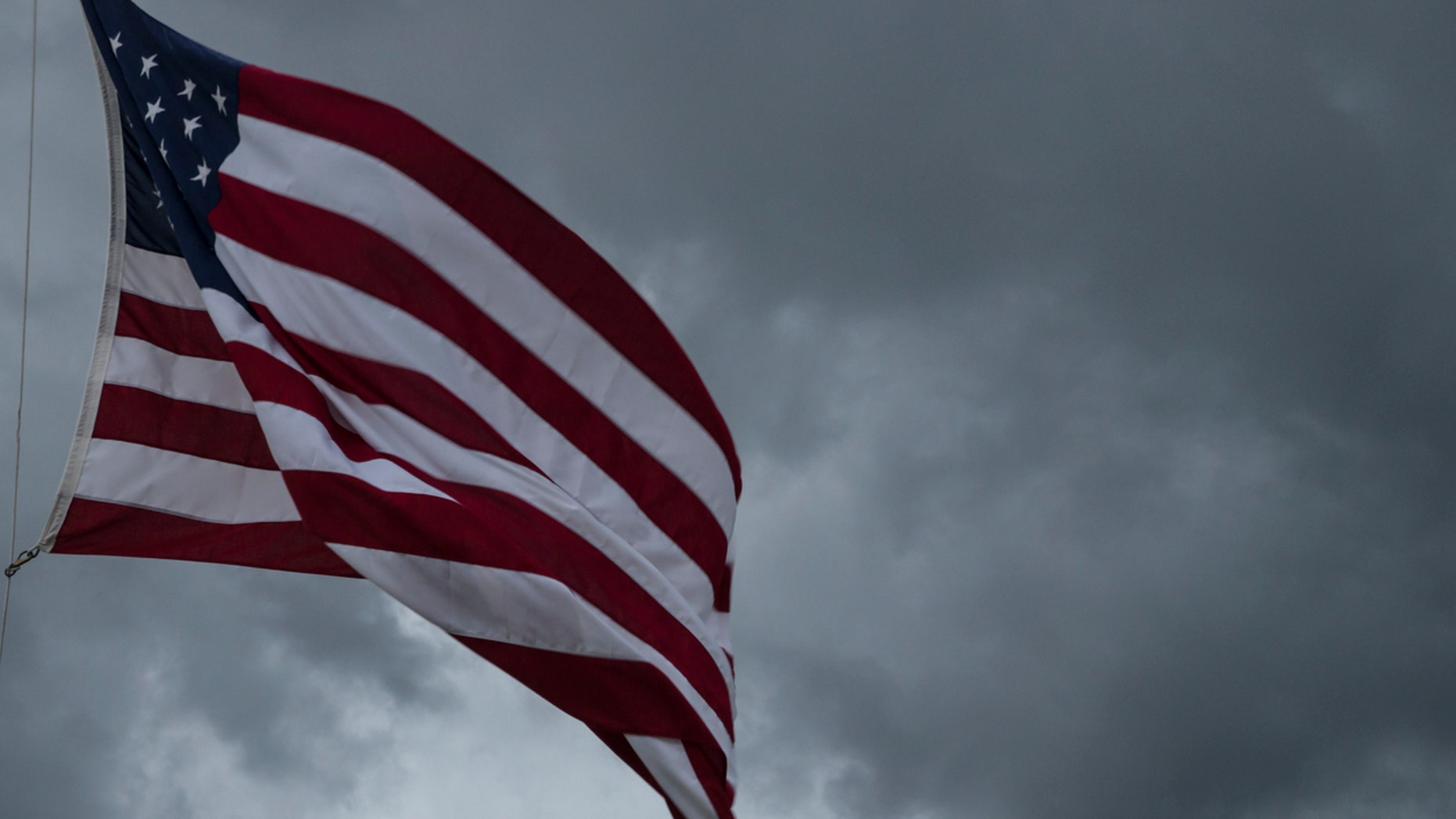 American Flag blowing in the wind of an approaching storm