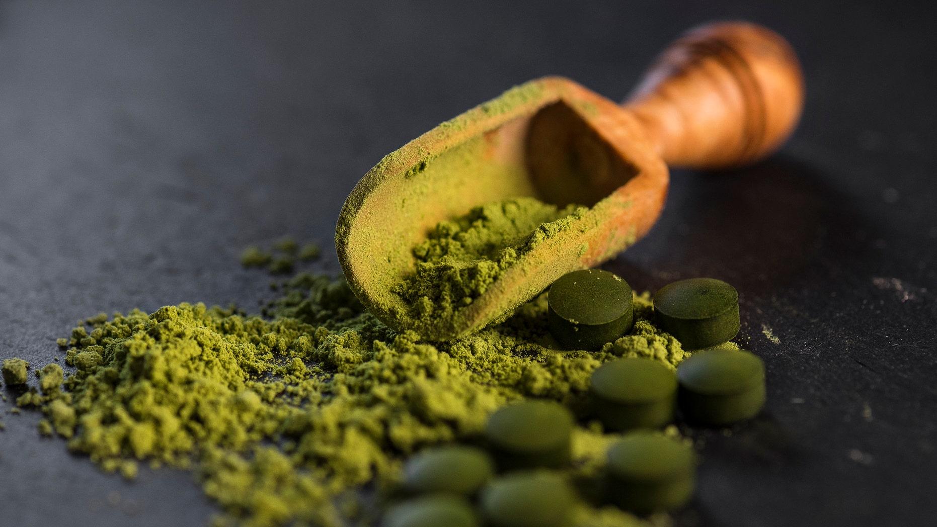 Organic chlorella powder and tablets shot on a slate