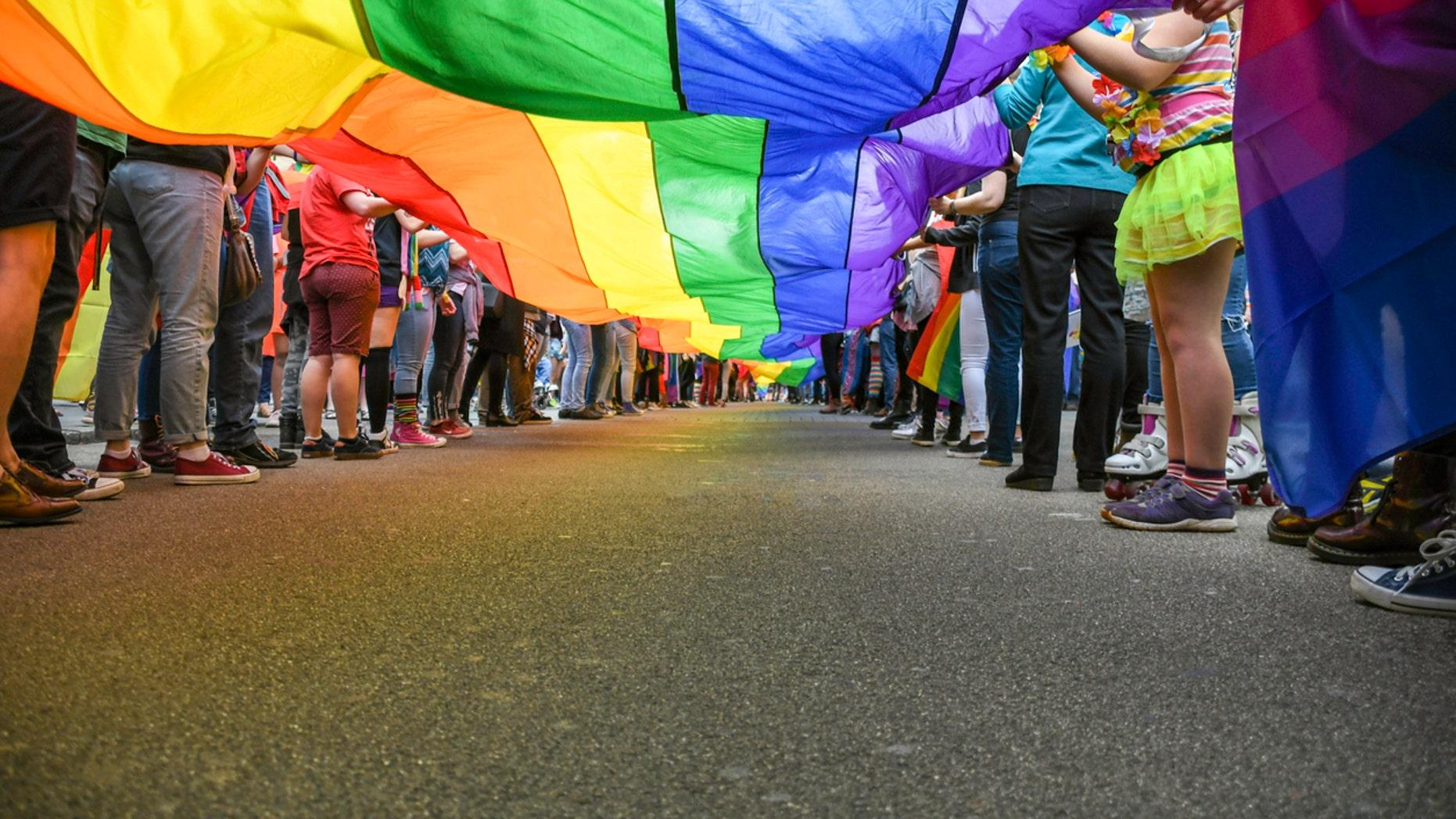 Under a LGBT Pride Flag, taken at Exeter Pride Parade, public event.