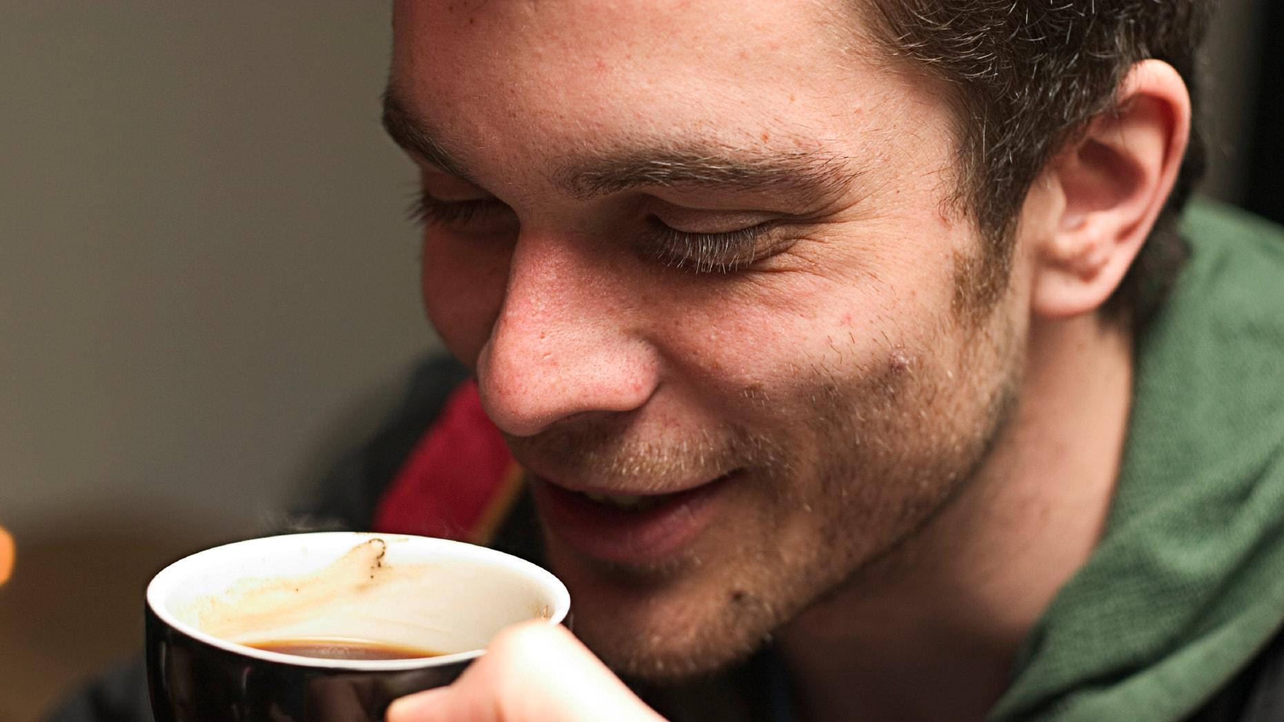 Young man enjoying a nice warm cup of coffee.