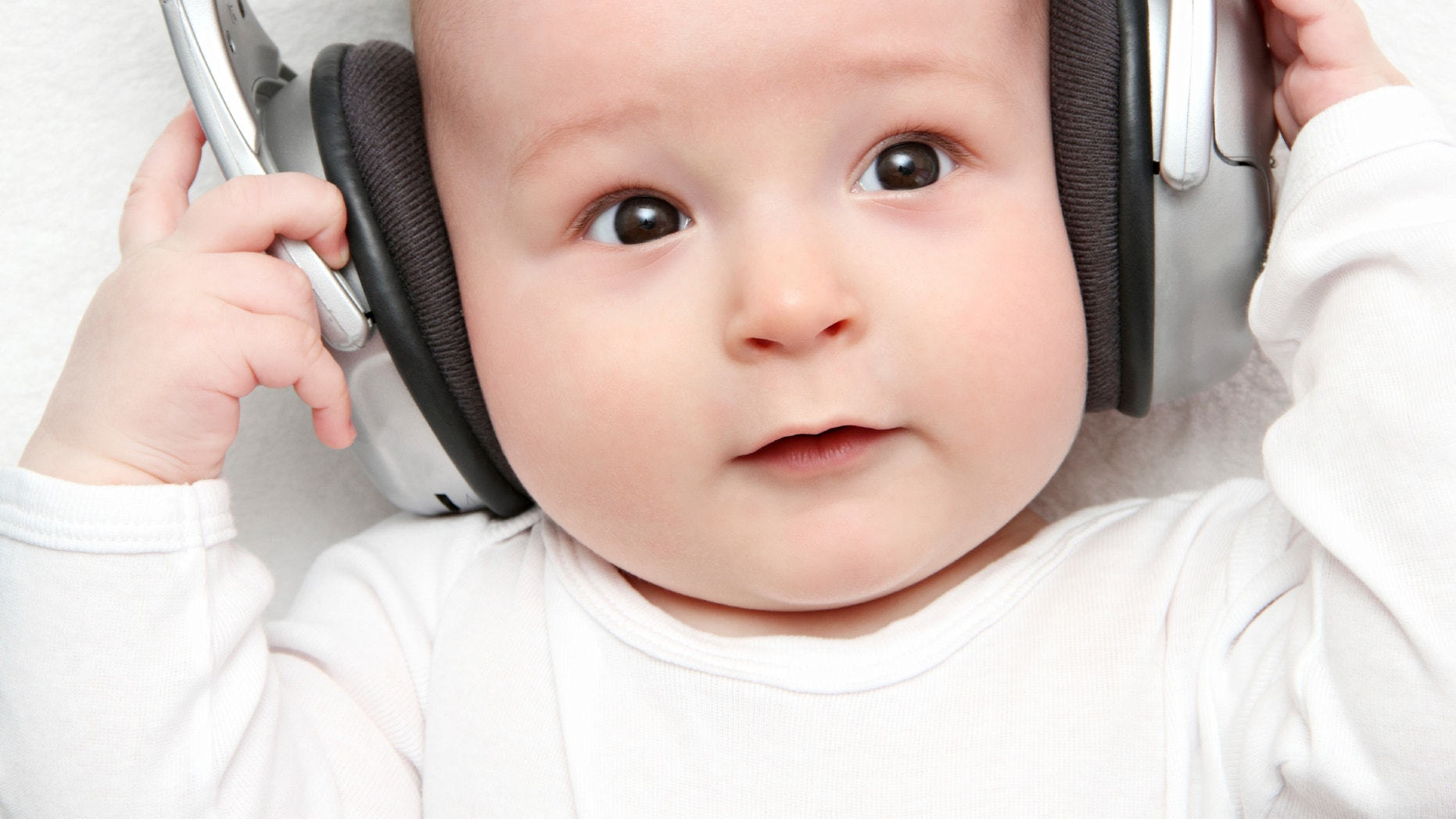 baby listening music on back