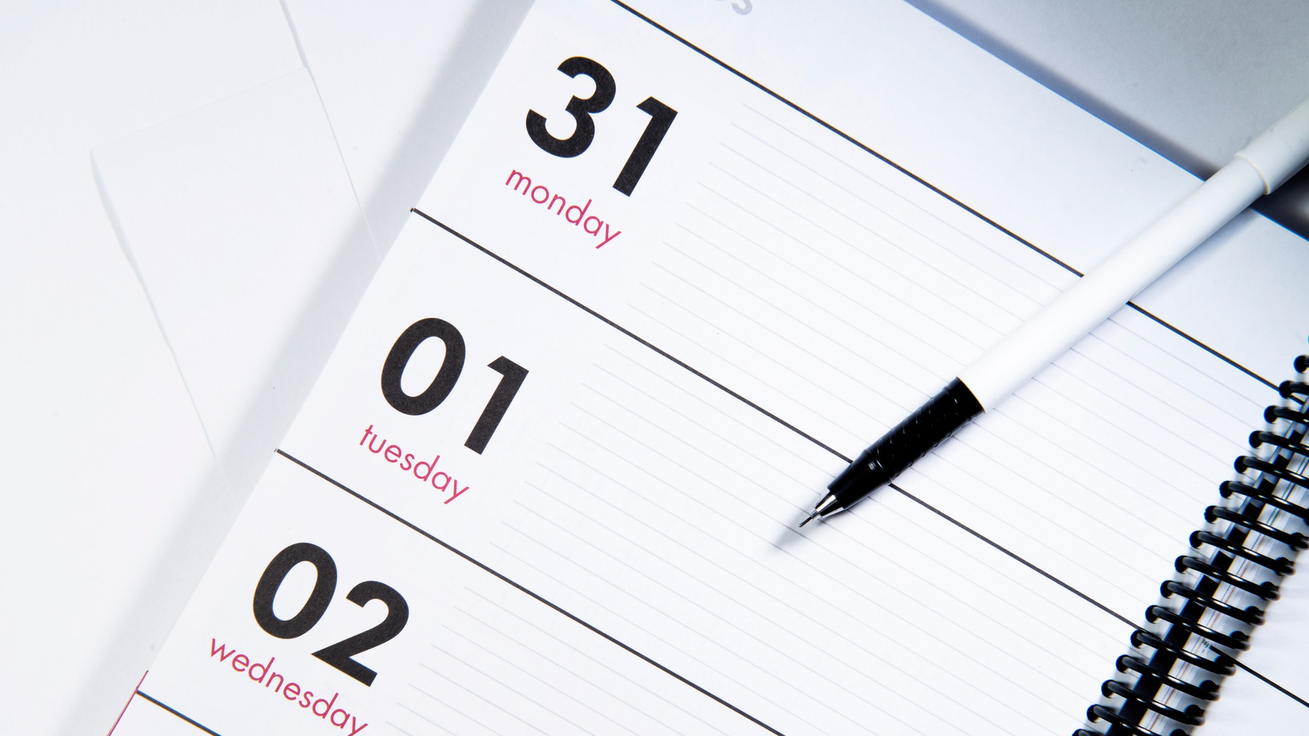 A pen on the calendar, seems somebody want to make a plan.