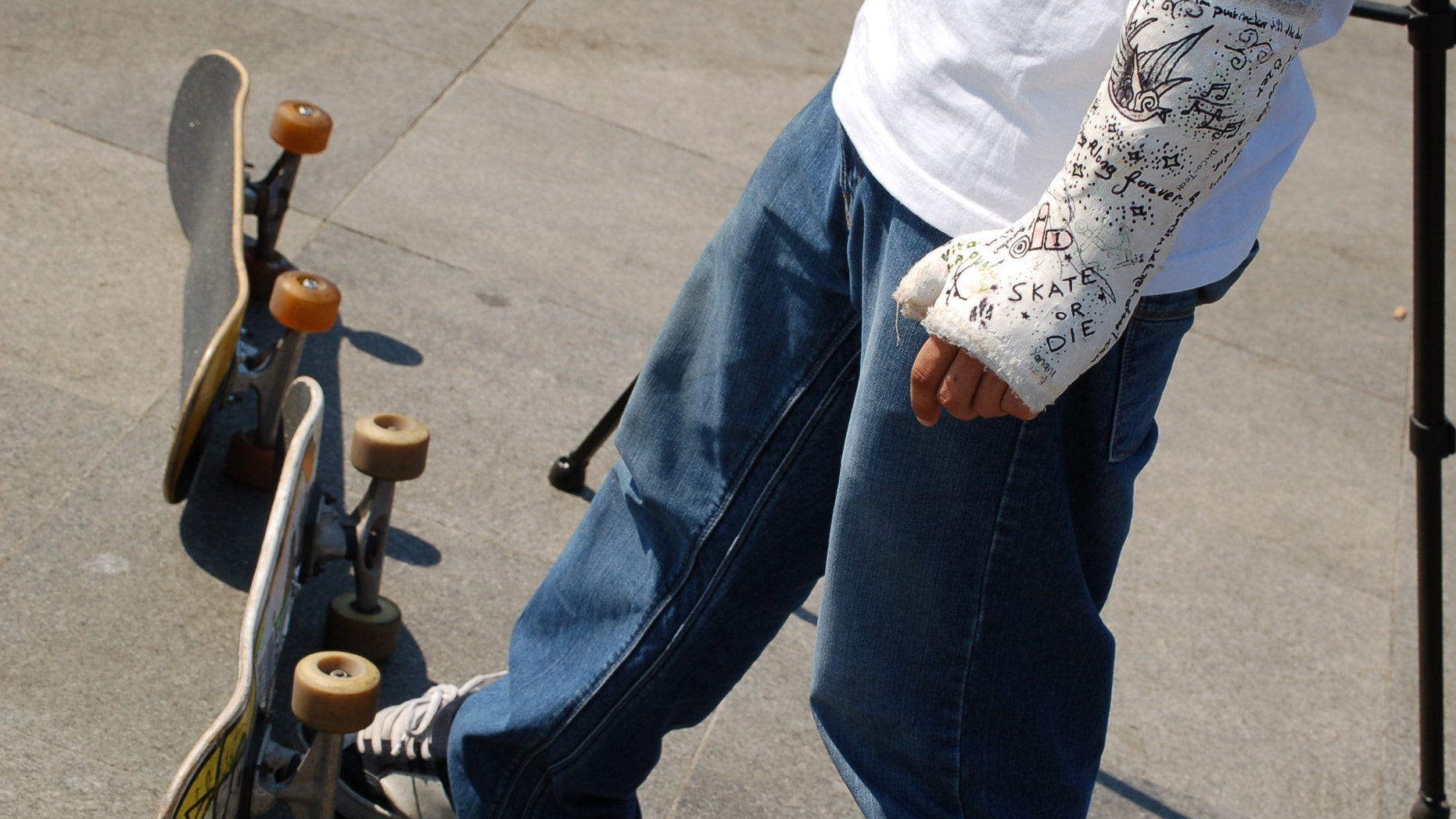 a young skater in Istanbul he has a very nice plaster in his wrist.