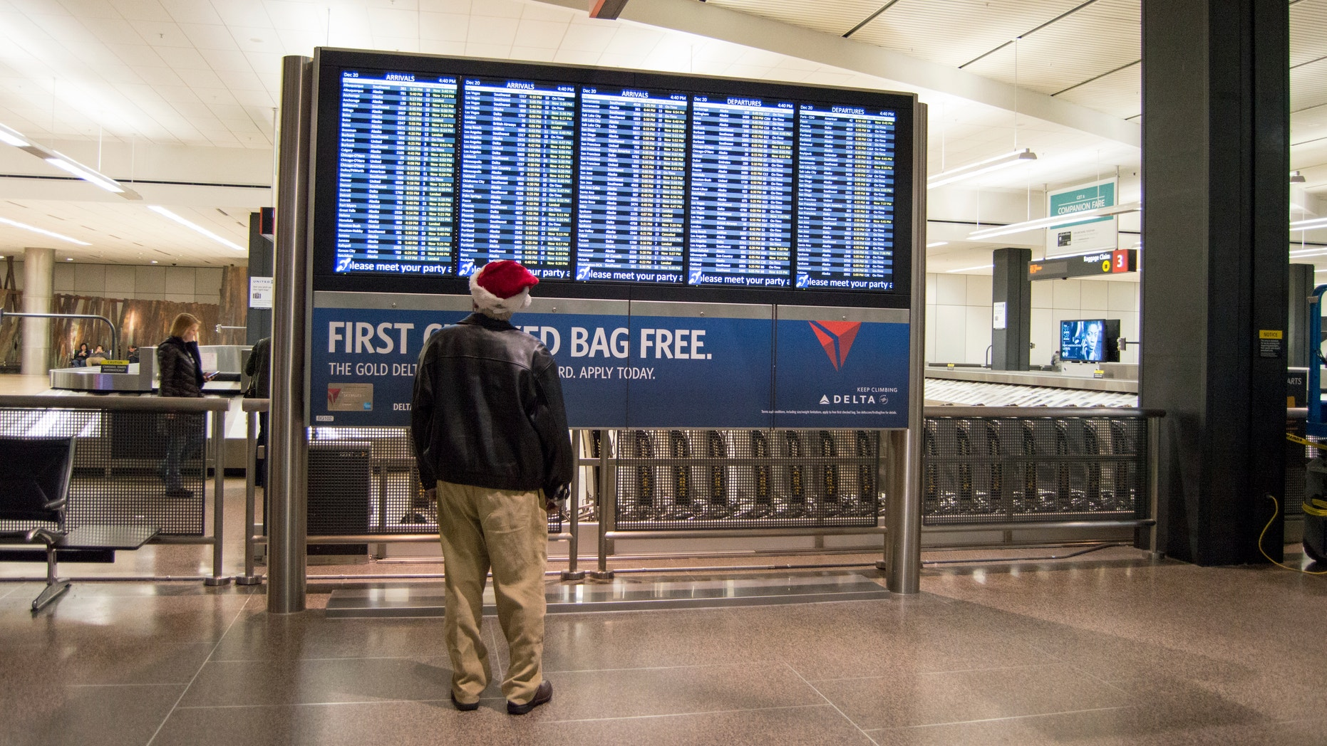 Seattle, WA, USA - December,20,2014 : A man standing in front of a billboard at the Seattle Airport