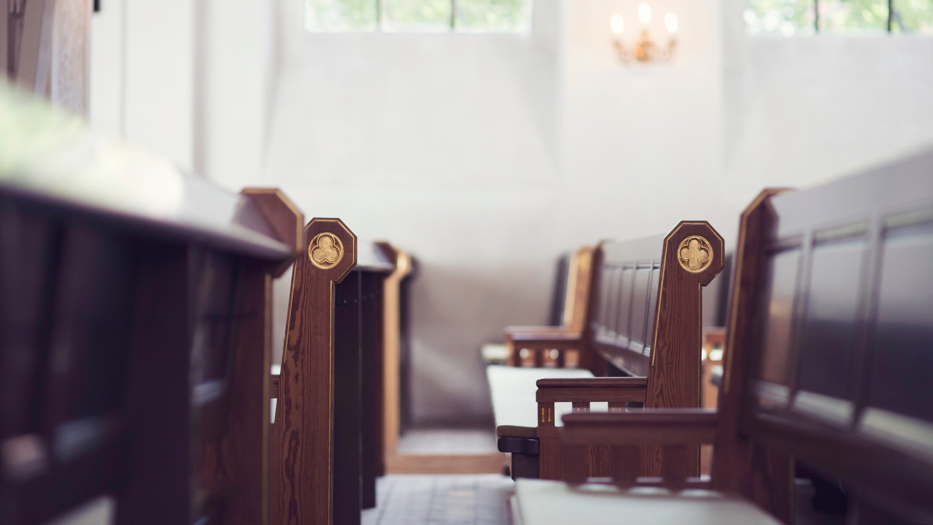 Two rows of benches in a church