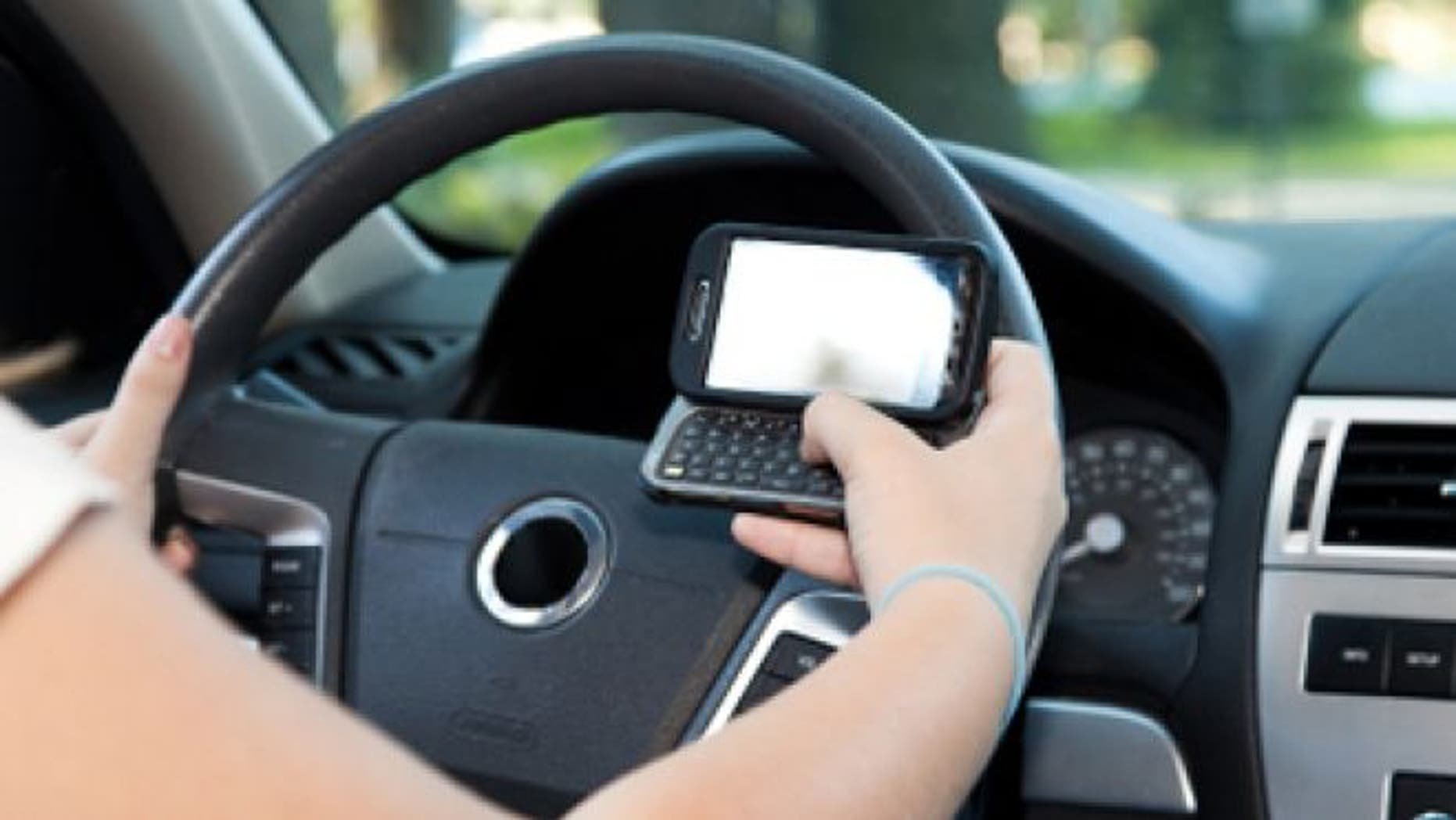 FILE: A New Jersey court has found a person who knowingly sends a text to a driver can be held liable if the driver causes an accident.