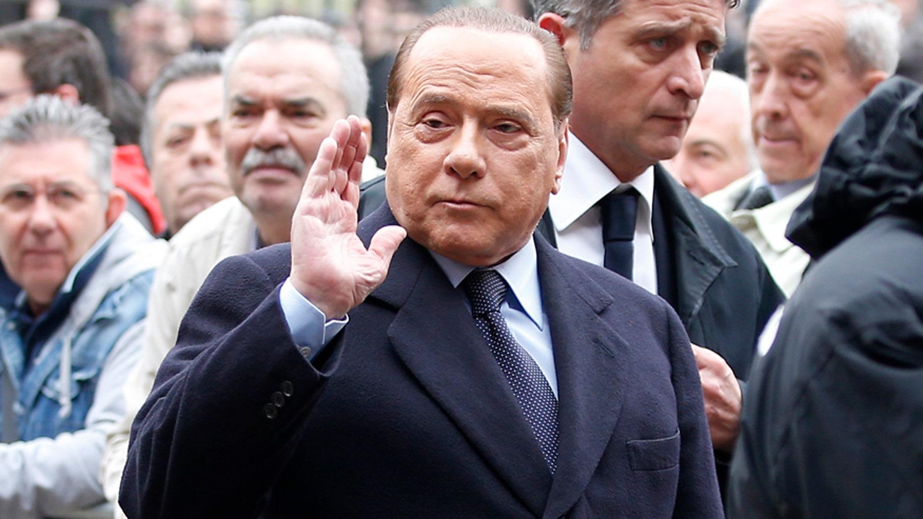 April 5, 2016: Former Premier Silvio Berlusconi attends the funeral of Italy coach Cesare Maldini at the Sant Ambrogio's Basilica in Milan, Italy.
