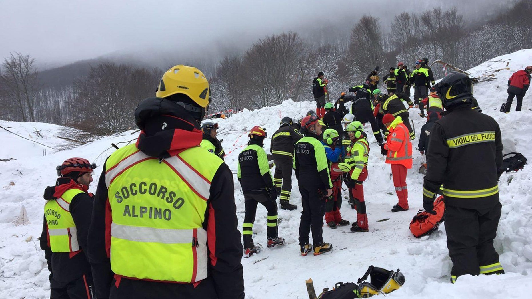Rescuers work in the area of the avalanche-hit Rigopiano hotel, Saturday, Jan. 21, 2017.
