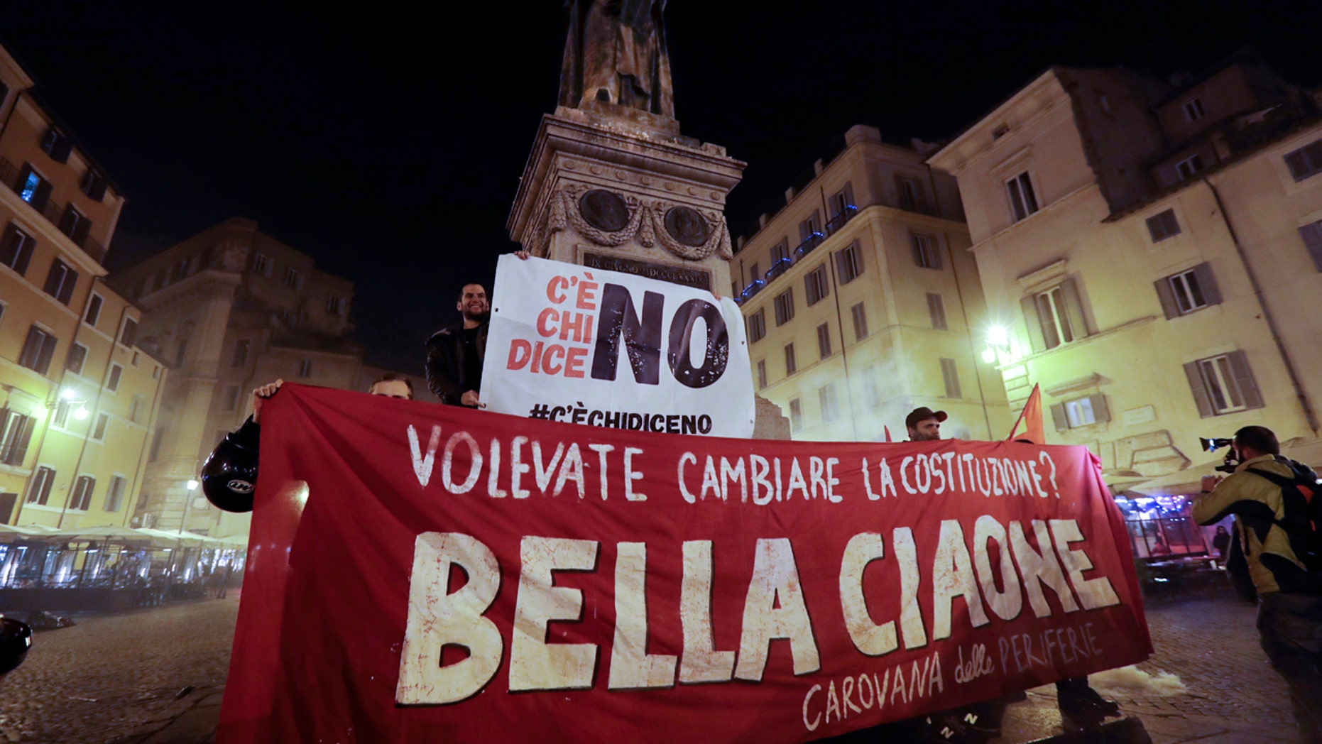 Anti-referendum militants gather in downtown Rome after Italian Premier Matteo Renzi conceded defeat in a constitutional referendum and announced he will resign in Rome, early Monday, Dec. 5, 2016.