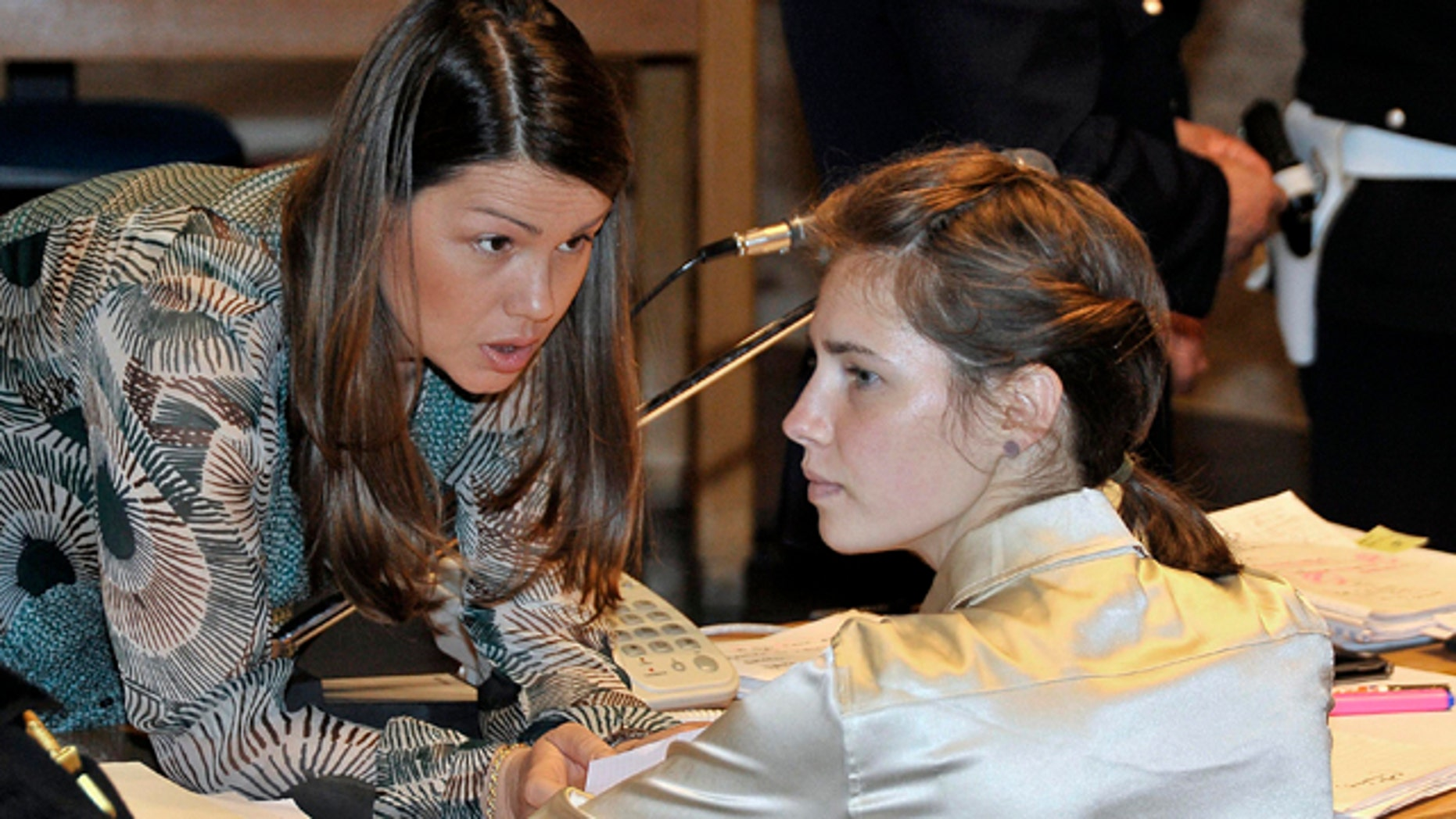 May 21: Amanda Knox, right, listens to her lawyer Maria Del Grosso, at the Perugia court, Italy.