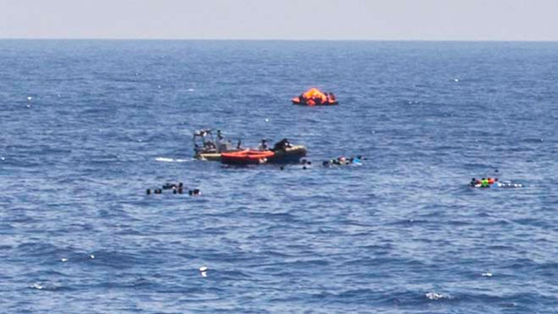 Aug. 5: The scene of the capsizing and sinking of a fishing boat crowded with migrants is seen from the deck of the Dignity I MSF search and rescue vessel which responded to the emergency in the Mediterranean sea off Libya.