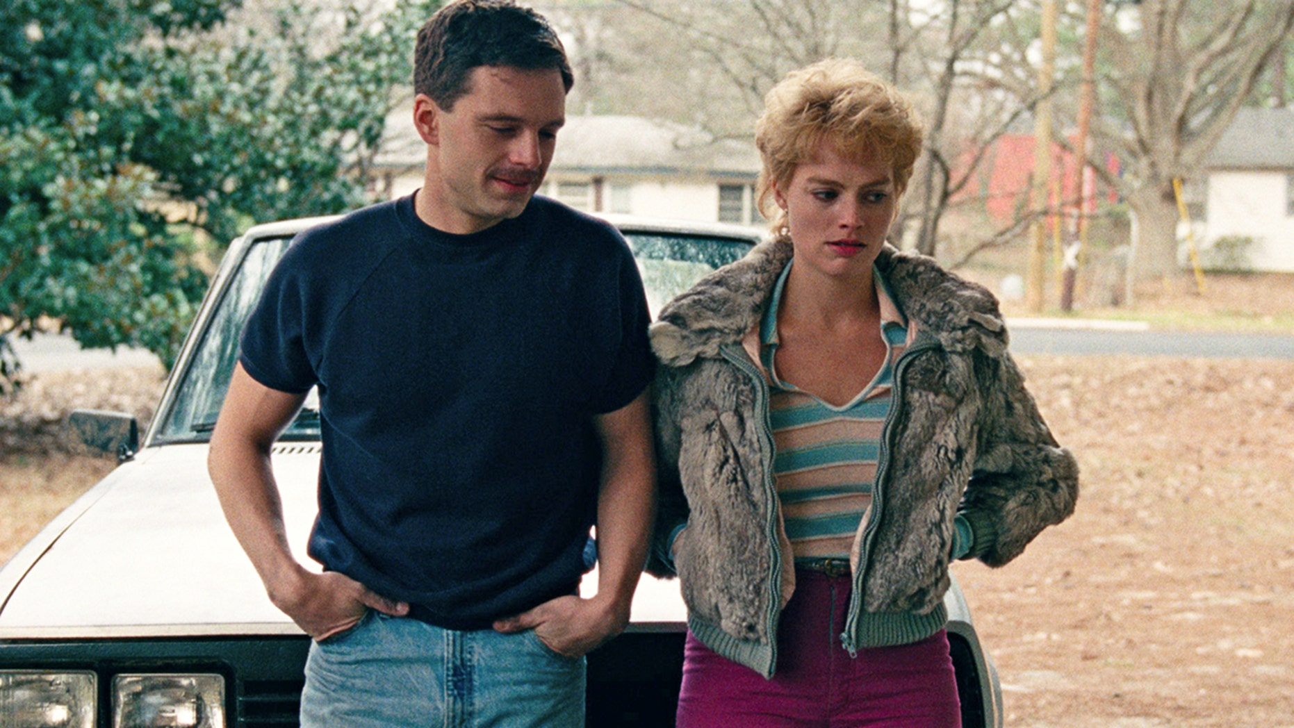 """This image released by Neon shows Sebastian Stan as Jeff Gillooly, left, and Margot Robbie as Tonya Harding in a scene from """"I, Tonya."""" On Monday, Dec. 11, 2017, Robbie was nominated for a Golden Globe for best actress in a motion picture comedy or musical for her role in the film."""