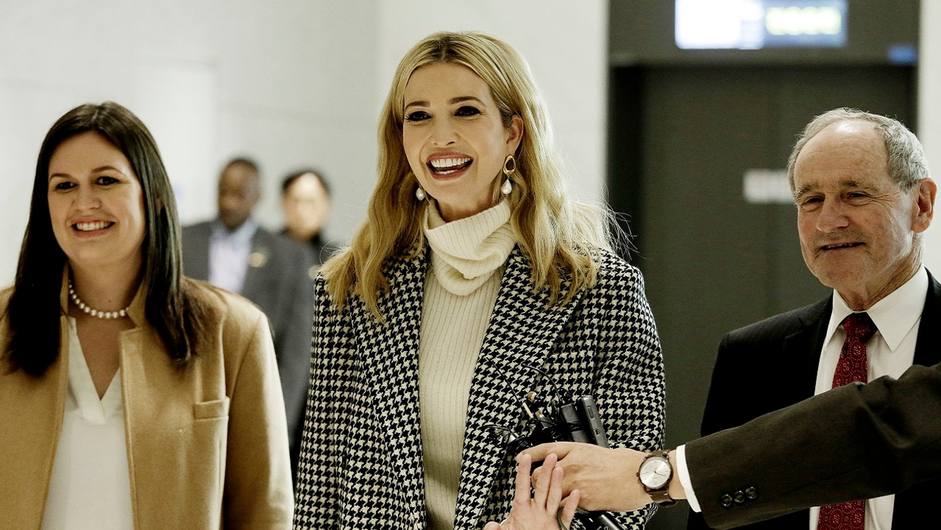 Ivanka Trump, daughter of U.S. President Donald Trump, arrives at the Incheon International Airport in Incheon, South Korea, Feb. 23, 2018. At left is White House press secretary Sarah Sanders.