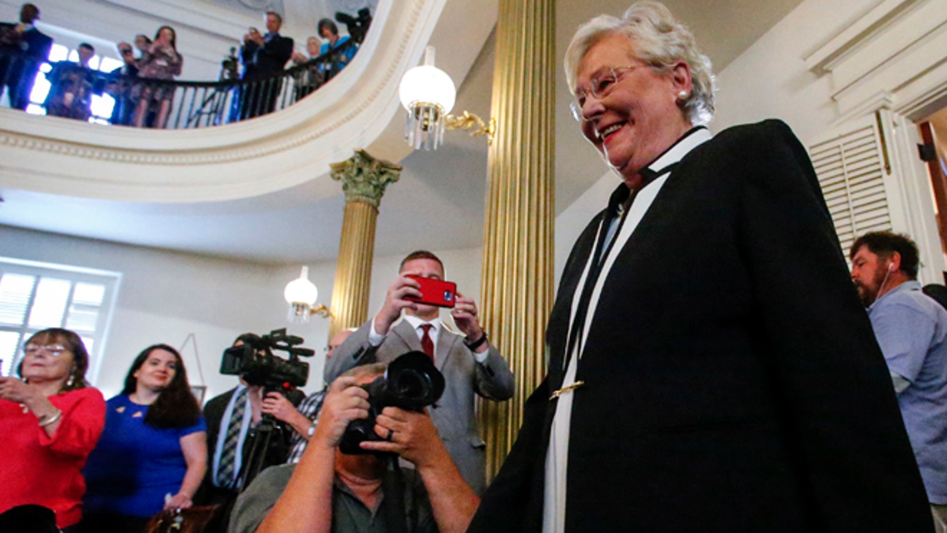 April 10, 2017: Kay Ivey walks in to be sworn in as the next Governor of Alabama in Montgomery, Ala.