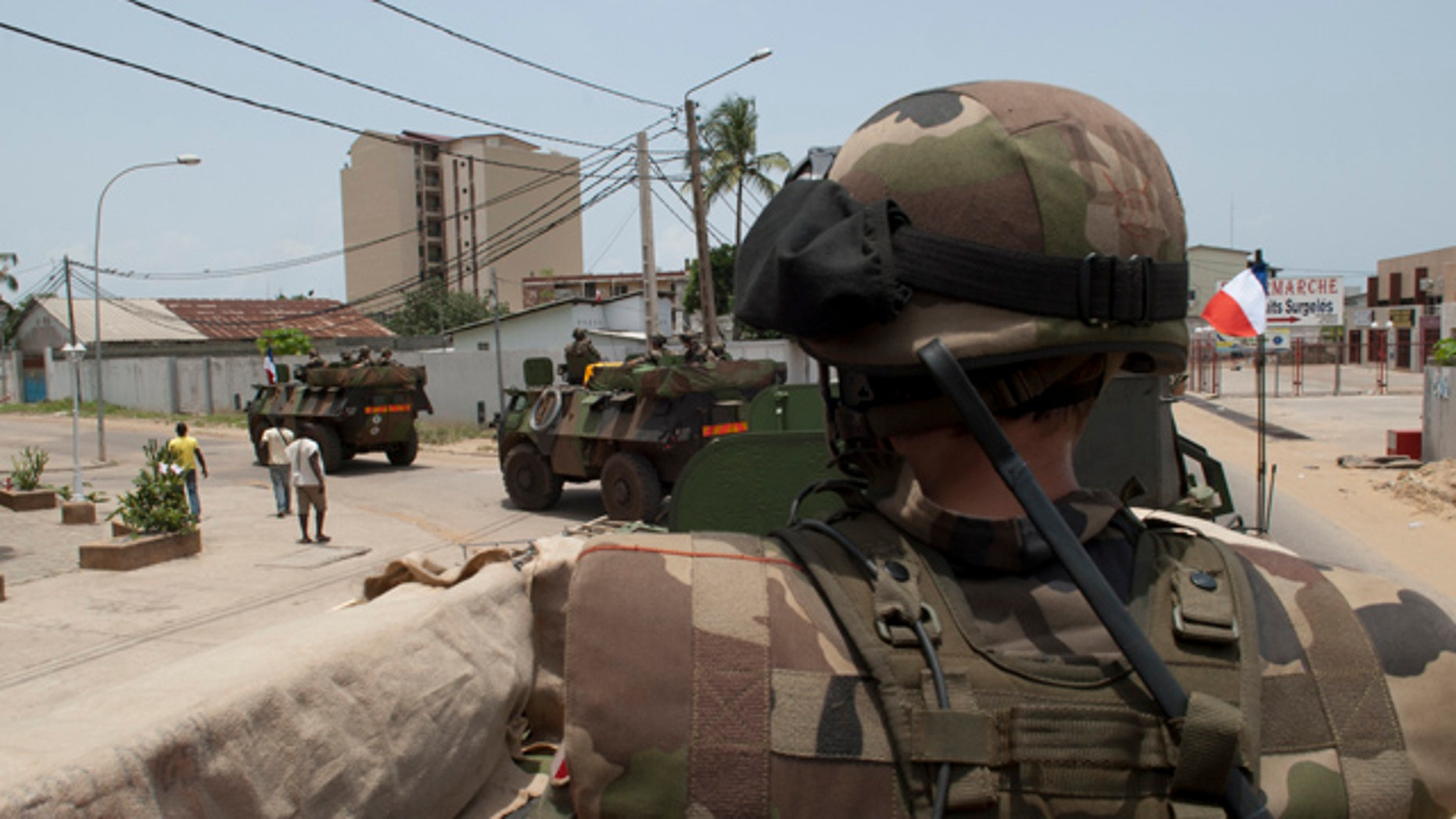 April 3, 2011: French soldiers patrol the Port Bouet district of Abidjan. President Obama has been criticized for paying little interest to the civil war gripping the Ivory Coast.