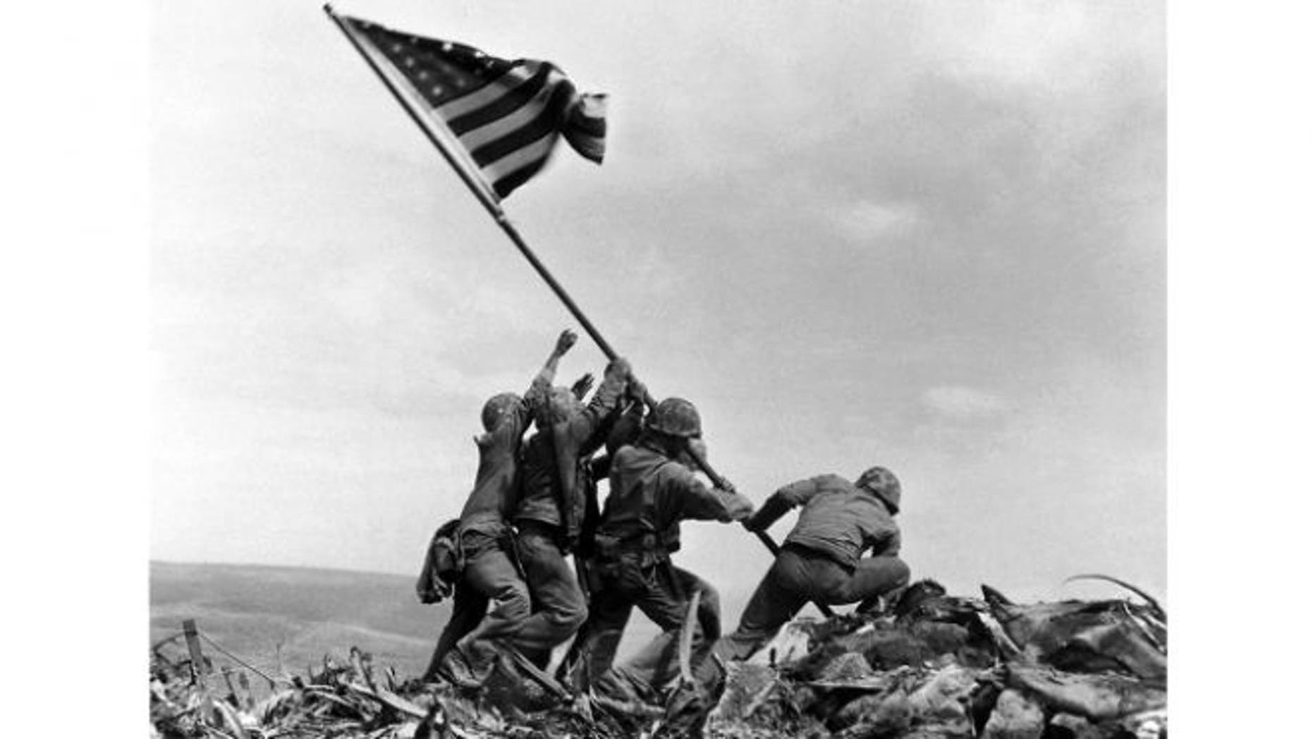 FILE: US Marines raise American flag on Mount Suribachi, Iwo Jima.