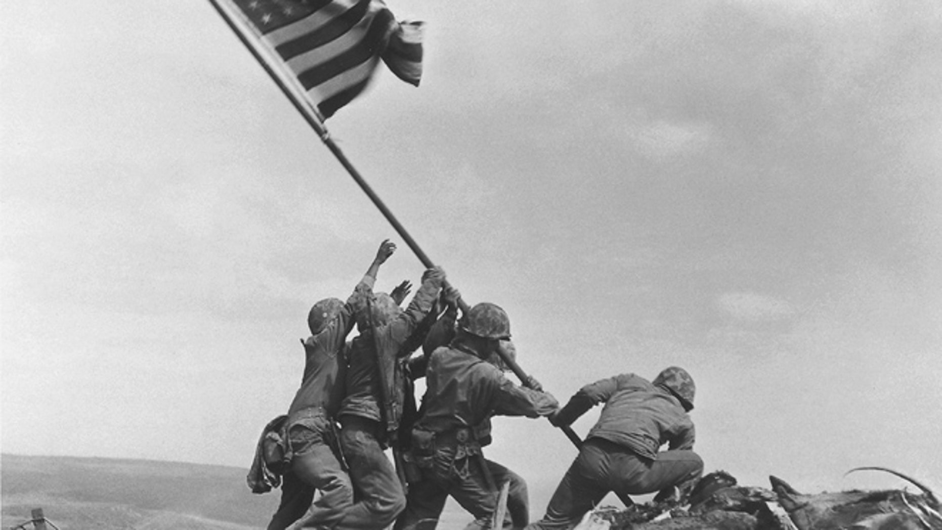 FILE - In this Feb 23, 1945 file photo, U.S. Marines of the 28th Regiment, 5th Division, raise the American flag atop Mt. Suribachi, Iwo Jima, Japan. (AP)