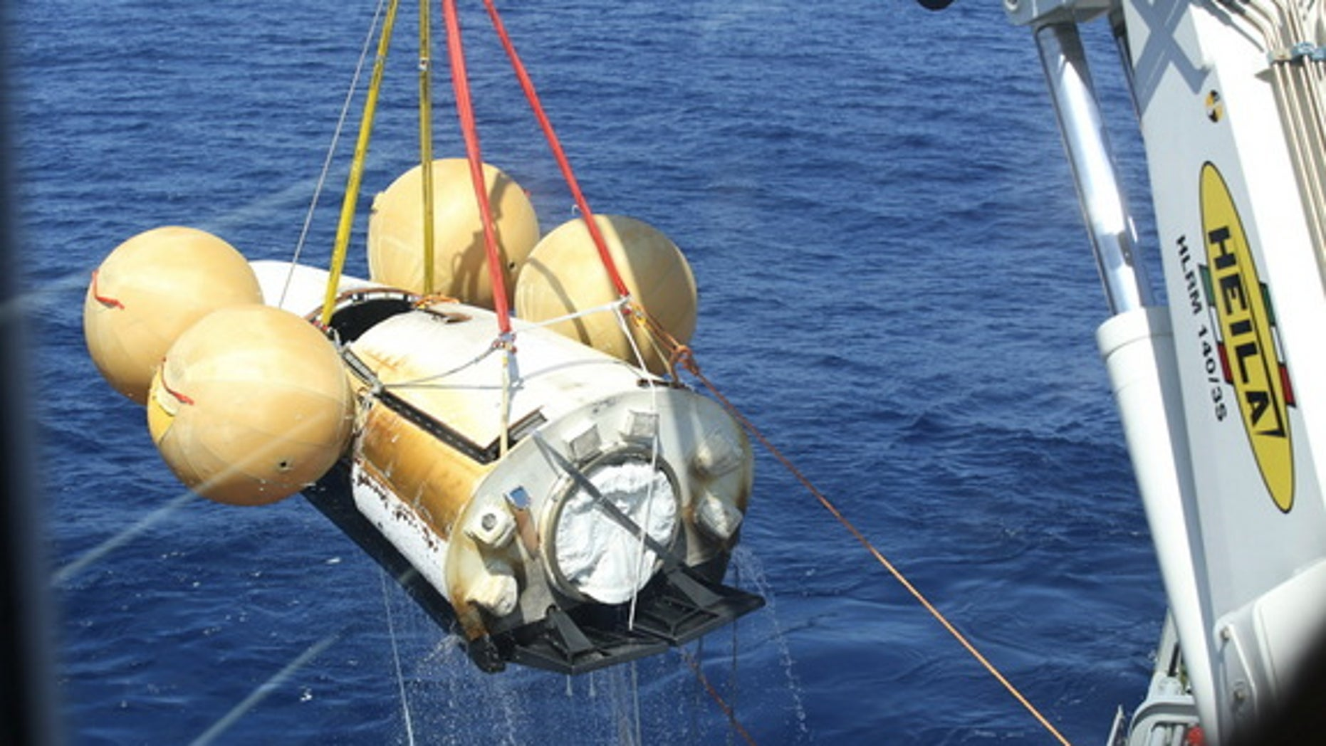 Europe's Intermediate eXperimental Vehicle robotic space plane is pulled out of the ocean after its first test flight on Feb. 11, 2015. European Space Agency officials are already planning the spacecraft's next test.