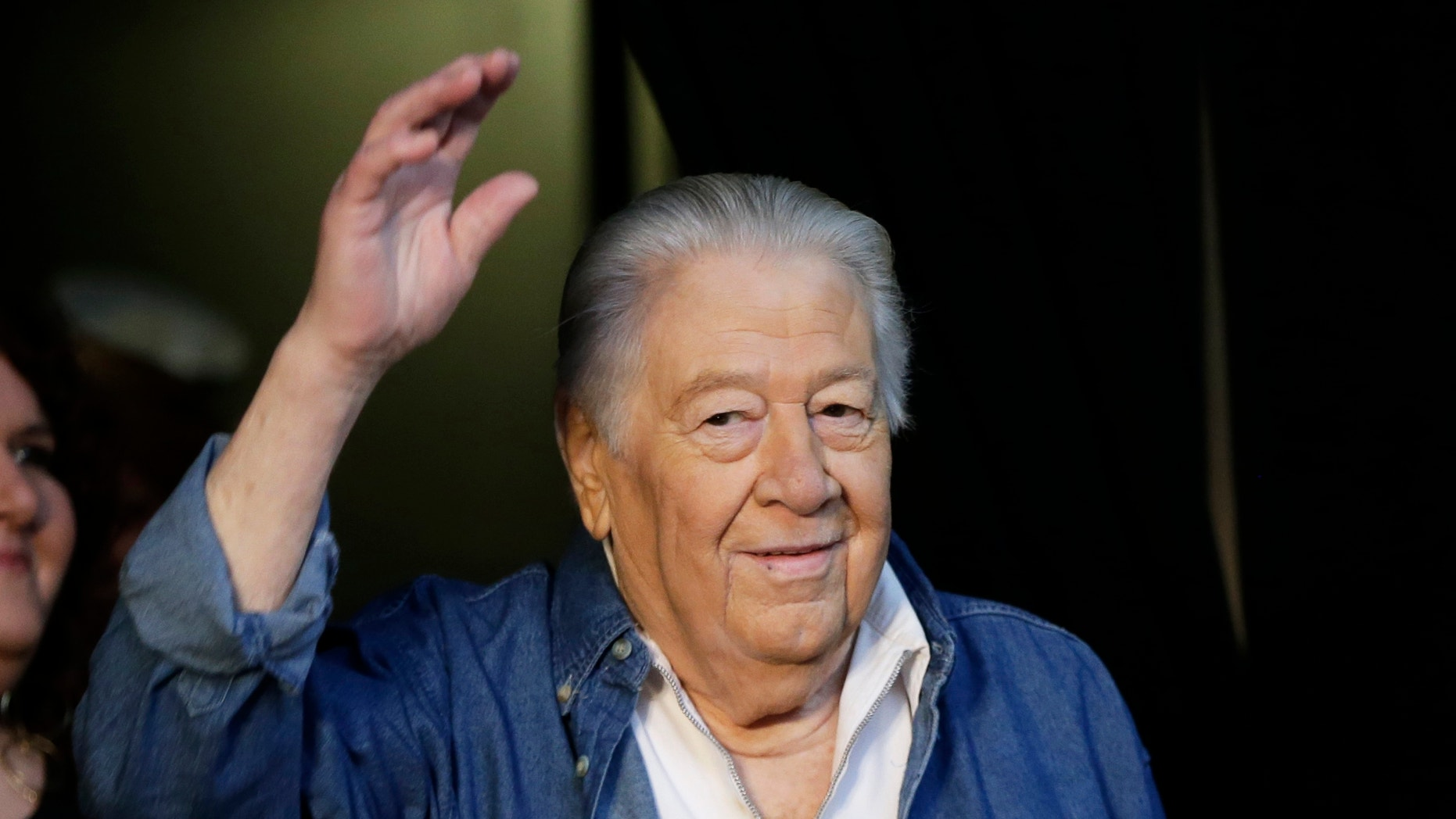 In this April 10, 2013 file photo, Jack Clement poses for photographers at the Country Music Hall of Fame in Nashville, Tenn. Clement, a producer, engineer, songwriter and beloved figure who helped birth rock 'n' roll and push country music into modern times, died Thursday morning, Aug. 8. He was 82.