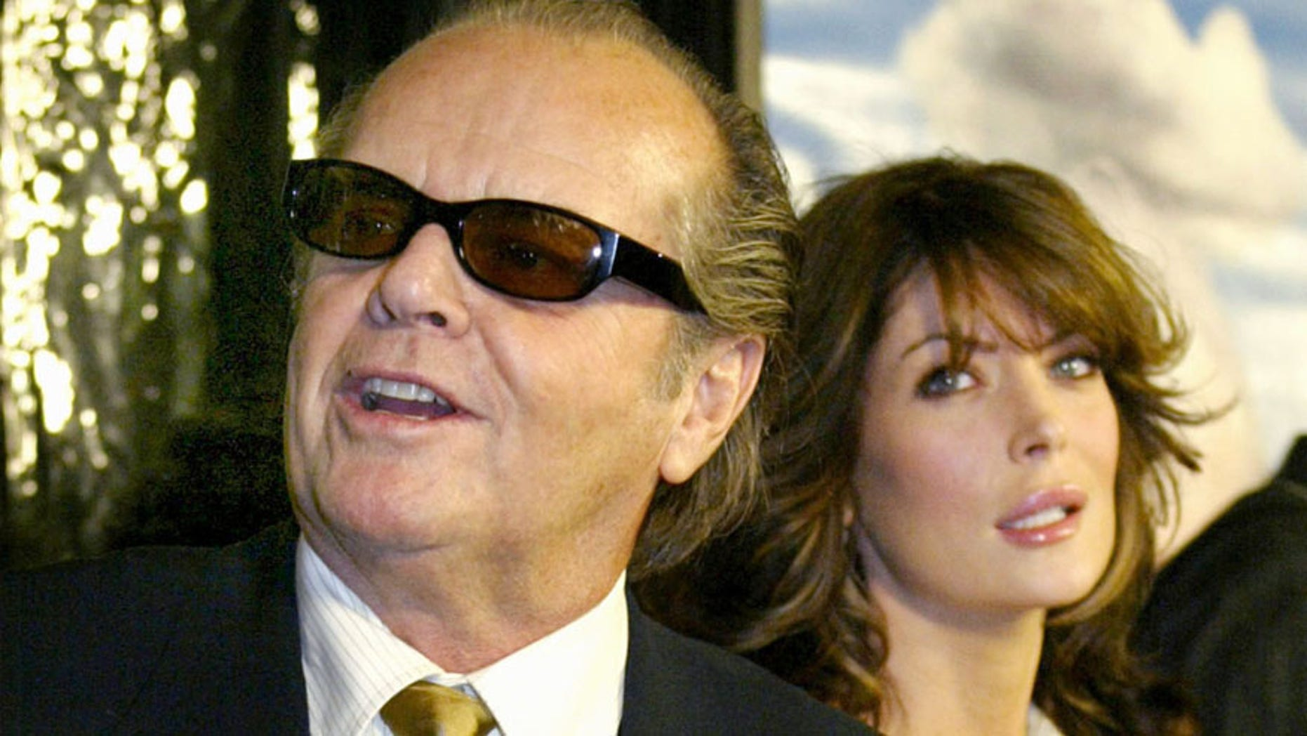 """Three-time Academy Award winning actor Jack Nicholson arrives with LaraFlynn Boyle for the Los Angeles premiere of the film """"About Schmidt,""""December 12, 2002 in Beverly Hills, California. Nicholson stars as a man whohas reached life's crossroads and is searching for something meaningful inhis life.   PP03110050   REUTERS/Robert GalbraithRG - RTRFBGF"""