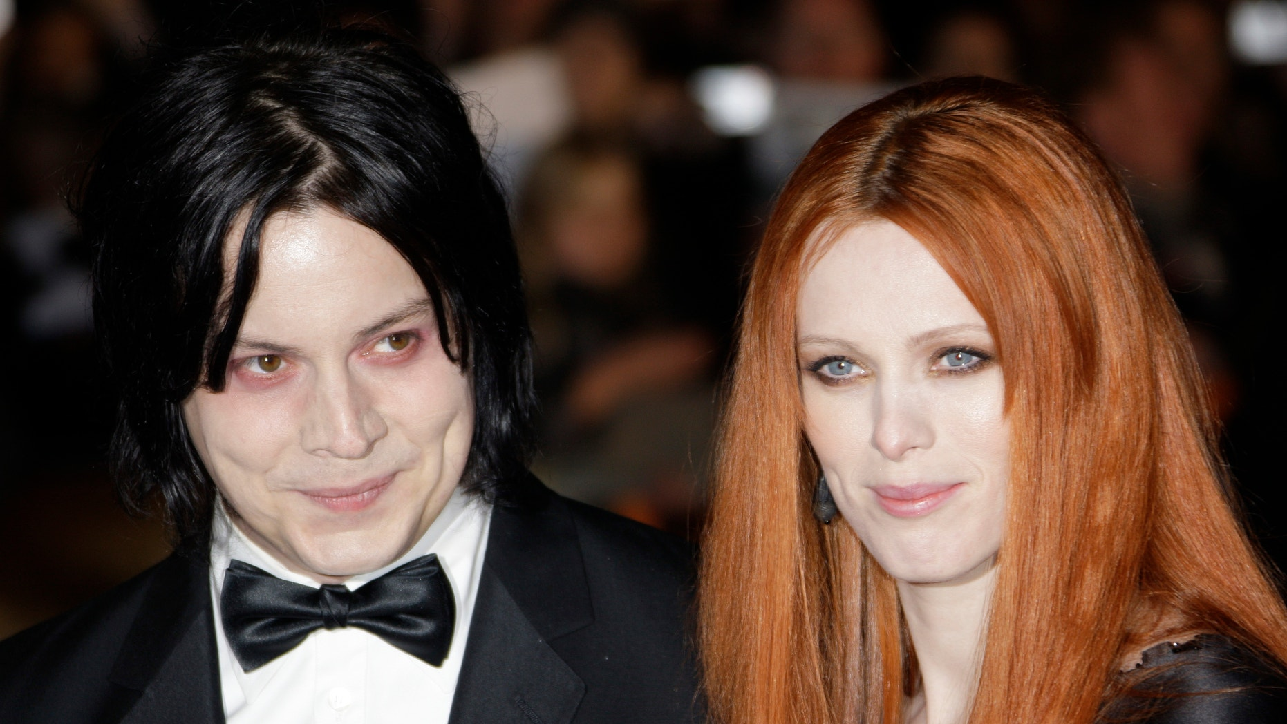 """In this Oct. 29, 2008 file photo, musician Jack White, left, and Karen Elson arrive on the red carpet for the Royal World Premiere of the 22nd James Bond film, """"Quantum of Solace"""" in London."""