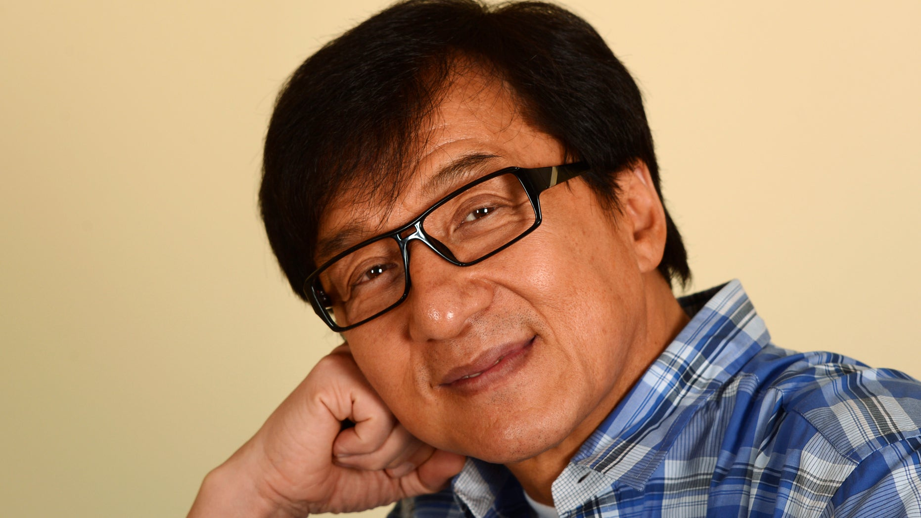 "Hong Kong actor Jackie Chan poses during a promotional event for his film ""Chinese Zodiac"" in Beverly Hills, California October 16, 2013. Hong Kong martial arts film star Chan, 59, who declared last year at France's Cannes film festival that he was retiring from action films, now says that after more than a decade of contemplating quitting, he is going to let his body decide. As Chan starts to enter his twilight years he laments how Hollywood typecasting may force him to begin using a stunt double for his acrobatic scenes as he believes Hollywood studios would never cast him in dramatic roles. Picture taken October 16, 2013. To match story PEOPLE-JACKIECHAN/      REUTERS/Phil McCarten (UNITED STATES - Tags: ENTERTAINMENT PROFILE HEADSHOT) - RTX14FYI"