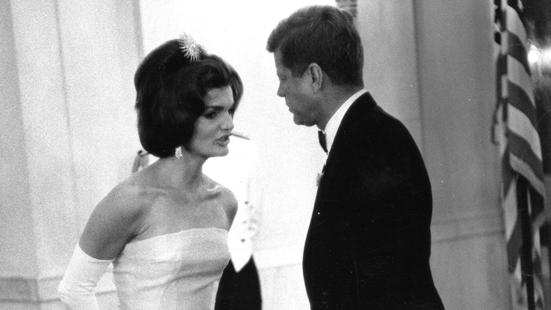 File photo. Former United States President John F. Kennedy and first lady Jackie Kennedy attend a dinner in honor of Andre Malraux, minister of state for cultural affairs of France, in Washington, in this handout image taken on May 11, 1962.