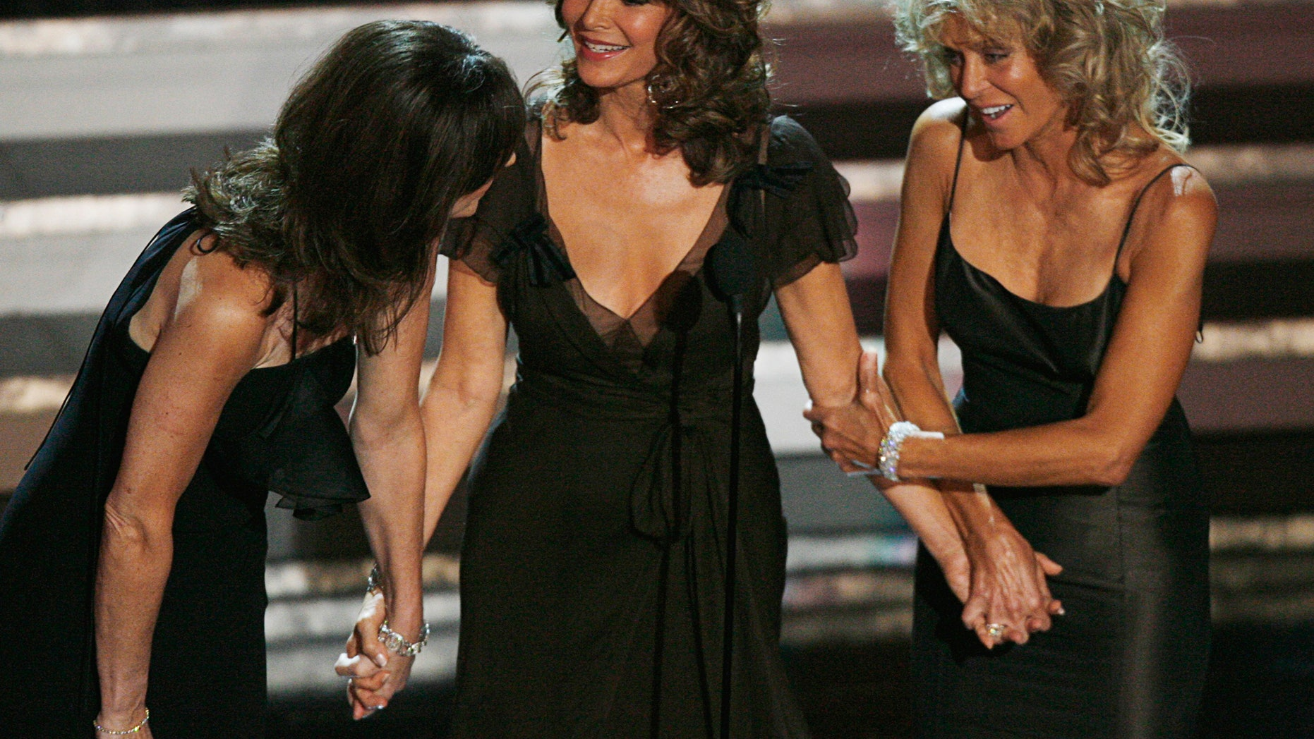 """Former """"Charlie's Angels"""" stars Kate Jackson,  Jaclyn Smith and Farrah Fawcett stand onstage during a tribute to Aaron Spelling at the 58th annual Primetime Emmy Awards at the Shrine Auditorium in Los Angeles August 27, 2006."""