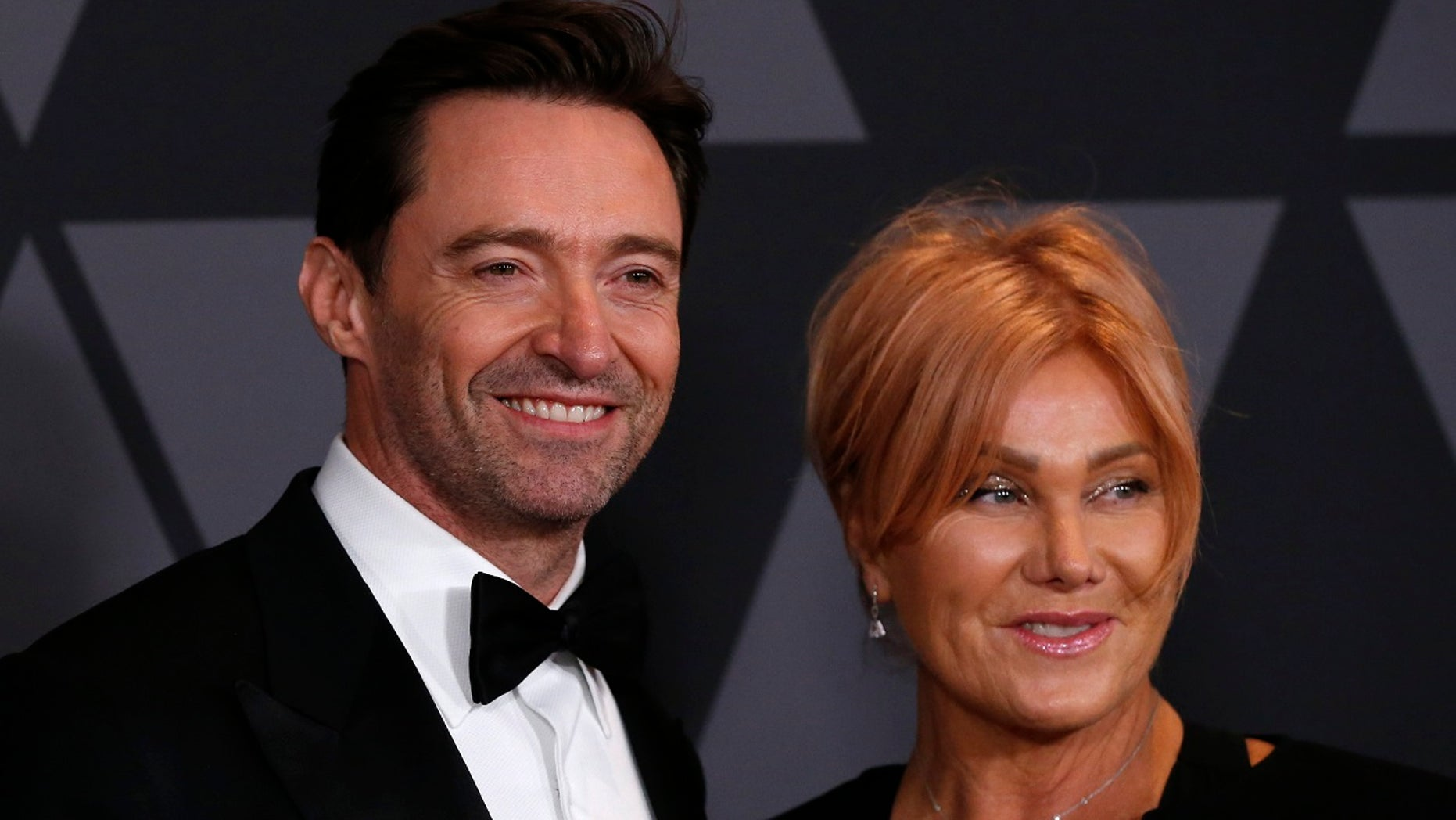 9TH Governors Awards – Arrivals – Los Angeles, California, U.S., 11/11/2017 - Actors and husband and wife Hugh Jackman and Deborra-lee Furness. REUTERS/Mario Anzuoni - HP1EDBC0C5WAJ