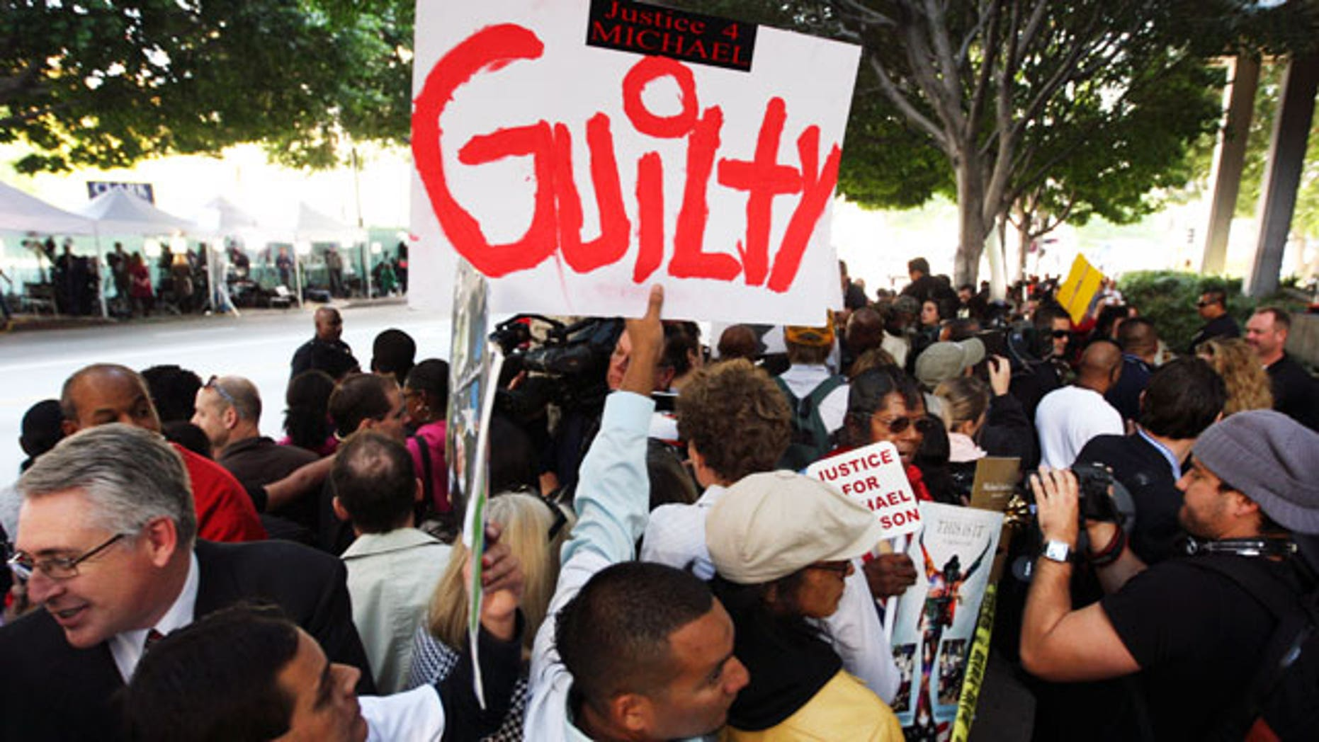 Nov. 7, 2011: Michael Jackson fans celebrate outside the courtroom.