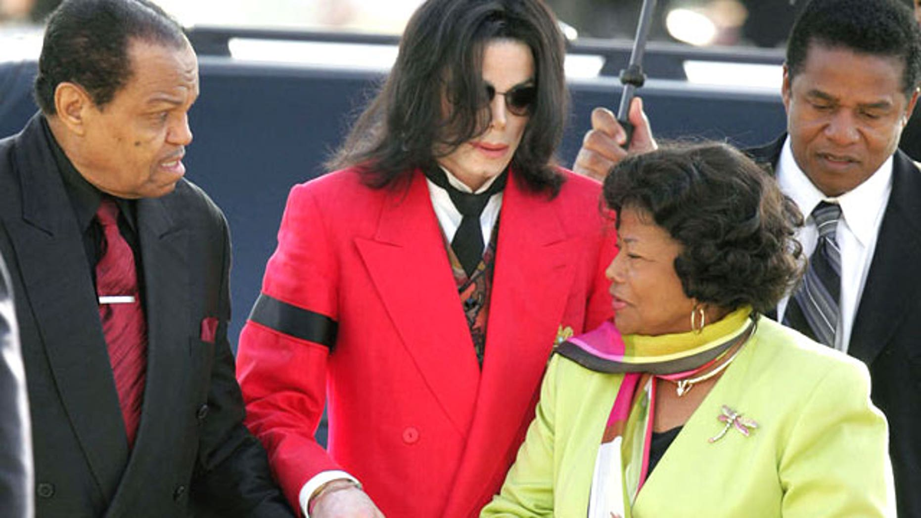Joseph Jackson, Michael Jackson, Katherine Jackson, and Jackie Jackson arrive at Santa Barbara County Superior Court for Michael's molestation trial on March 14, 2005. (AP)