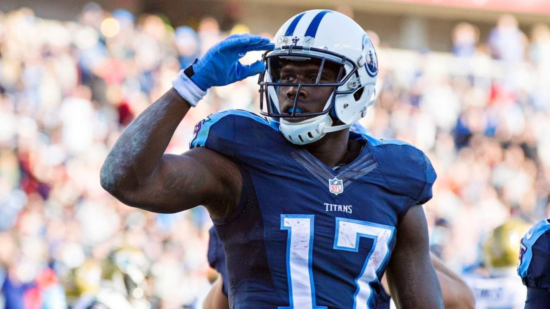 NASHVILLE, TN - DECEMBER 6: Dorial Green-Beckham #17 of the Tennessee Titans salutes the crowd after scoring a touchdown against the Jacksonville Jaguars at Nissan Stadium on December 6, 2015 in Nashville, Tennessee. The Titans defeated the Jaguars 42-39. (Photo by Wesley Hitt/Getty Images)