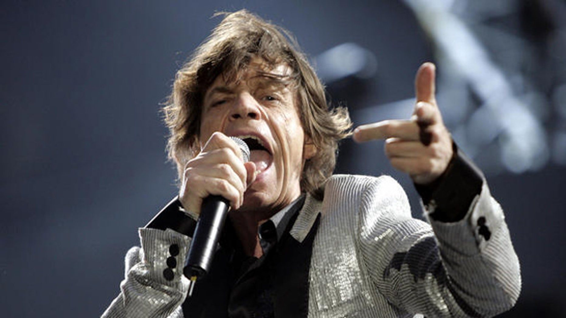 Mick Jagger performs during the Rolling Stones concert at the San Siro stadium in Milan, Italy, Tuesday, July 11, 2006. The Rolling Stones started their 'A Bigger Band' European tour in Milan. (AP Photo/Luca Bruno)