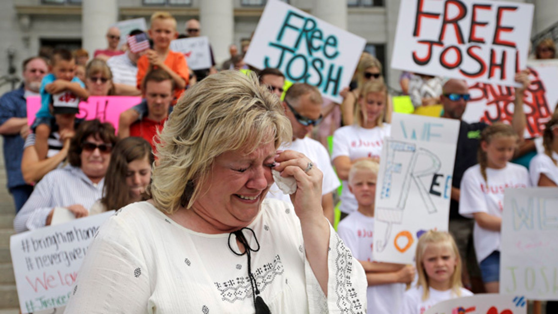 FILE - In this July 30, 2016, file photo, Laurie Holt, the mother of Joshua Holt, an American jailed in Venezuela, cries during a rally at the Utah State Capitol, in Salt Lake City.