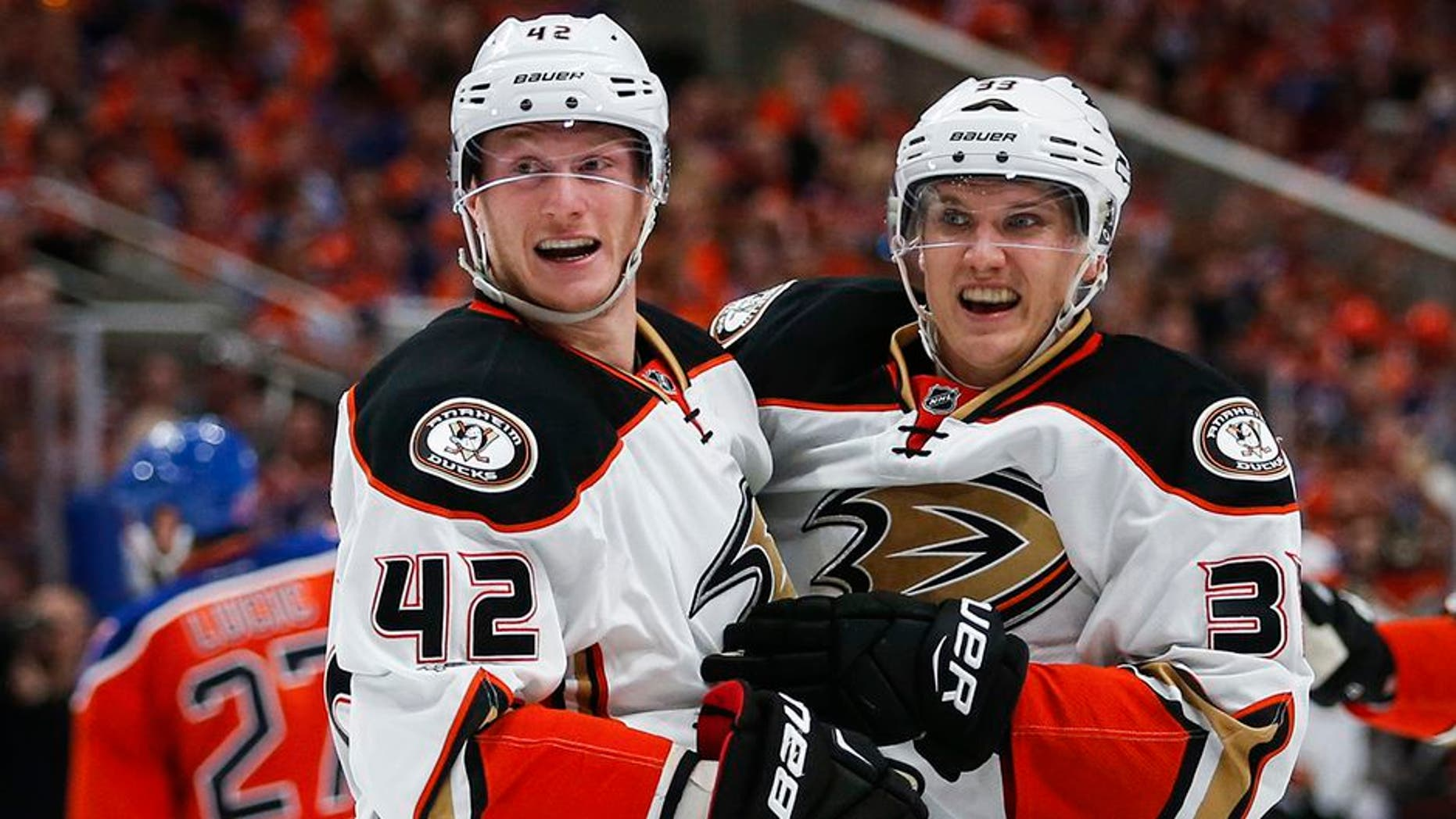 Anaheim Ducks' Jakob Silfverberg, right, from Sweden, celebrates his goal with teammate Josh Manson during the third period of Game 3 in a second-round NHL hockey Stanley Cup playoff series against the Edmonton Oilers in Edmonton, Alberta, Sunday, April 30, 2017. (Jeff McIntosh/The Canadian Press via AP)