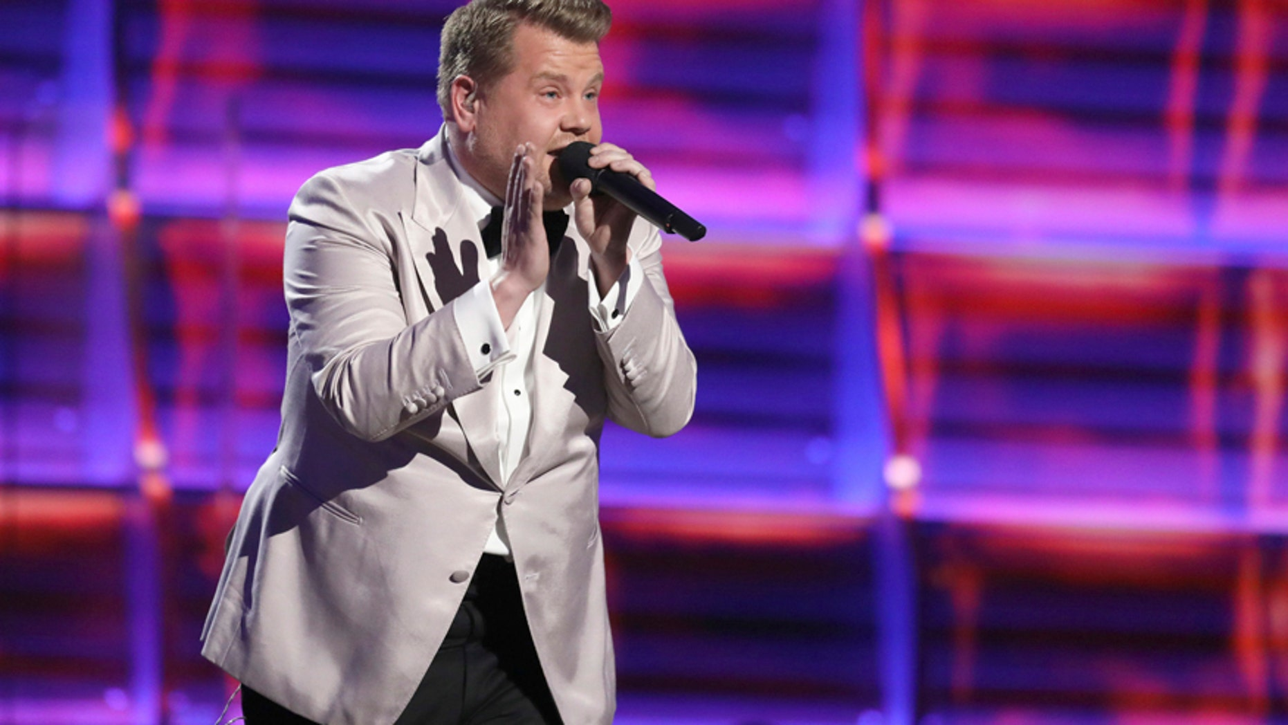 Host James Corden raps at the 59th annual Grammy Awards on Sunday, Feb. 12, 2017, in Los Angeles.