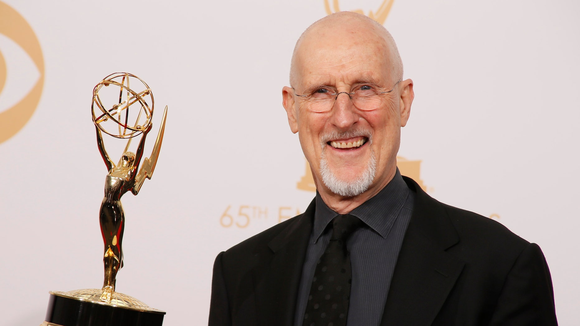 "Actor James Cromwell from FX's miniseries ""American Horror Story: Asylum"" poses backstage with his award for Outstanding Supporting Actor In A Miniseries Or A Movie at the 65th Primetime Emmy Awards in Los Angeles September 22, 2013. REUTERS"
