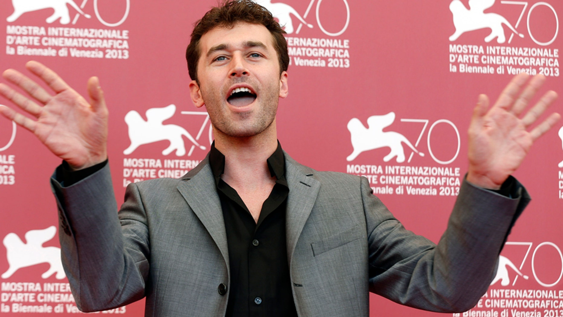 """Actor James Deen poses during a photocall during the 70th Venice Film Festival in Venice August 30, 2013. Actors Deen and Tenille Houston are in Paul Schrader's movie """"The Canyons"""", which debuts at the festival.  REUTERS/Alessandro Bianchi (ITALY - Tags: ENTERTAINMENT SOCIETY) - RTX131HS"""