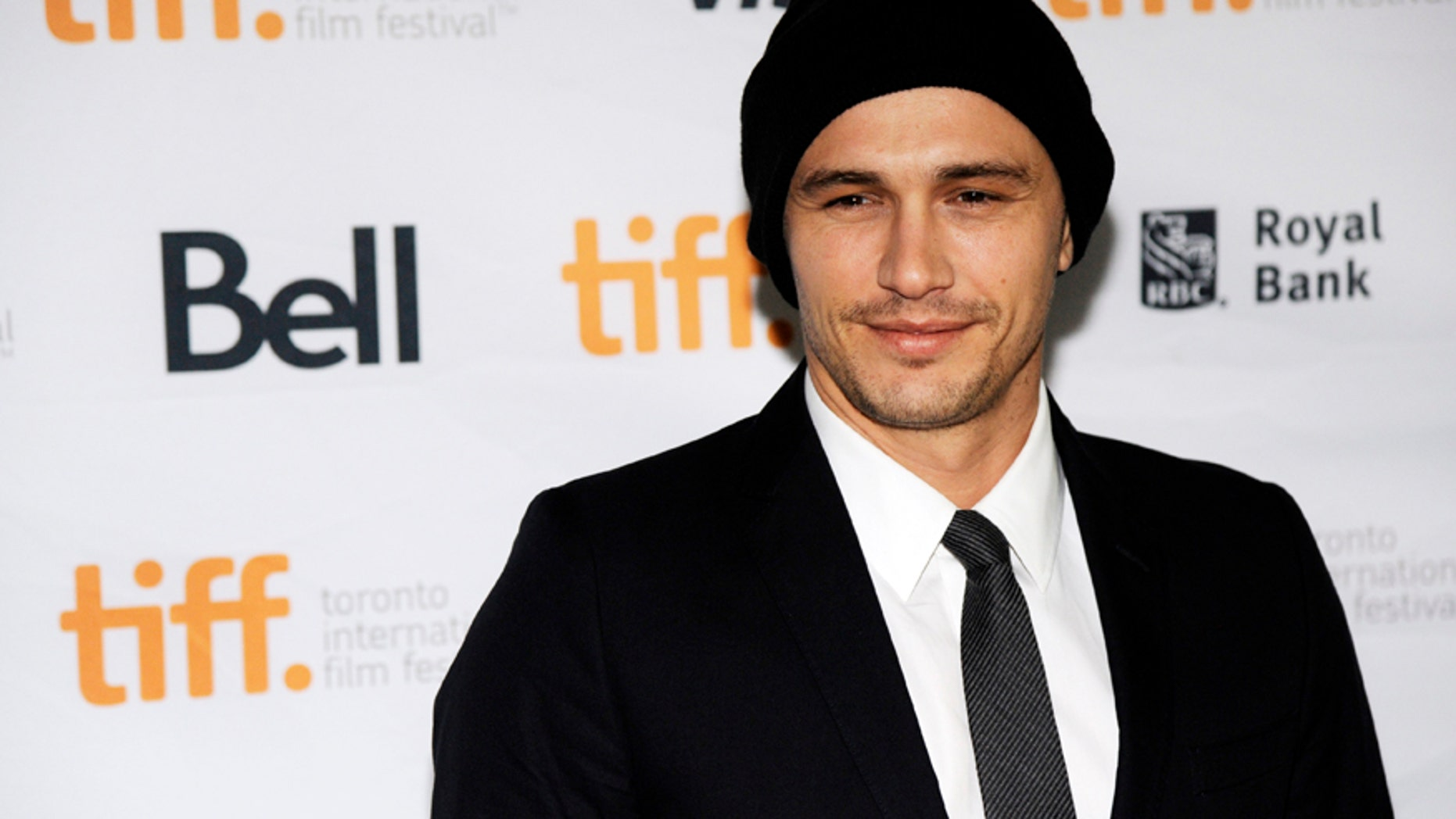 """James Franco, director of """"The Sound and the Fury,"""" poses at the premiere of the film at Ryerson Theatre during the 2014 Toronto International Film Festival on Saturday, Sept. 6, 2014, in Toronto."""