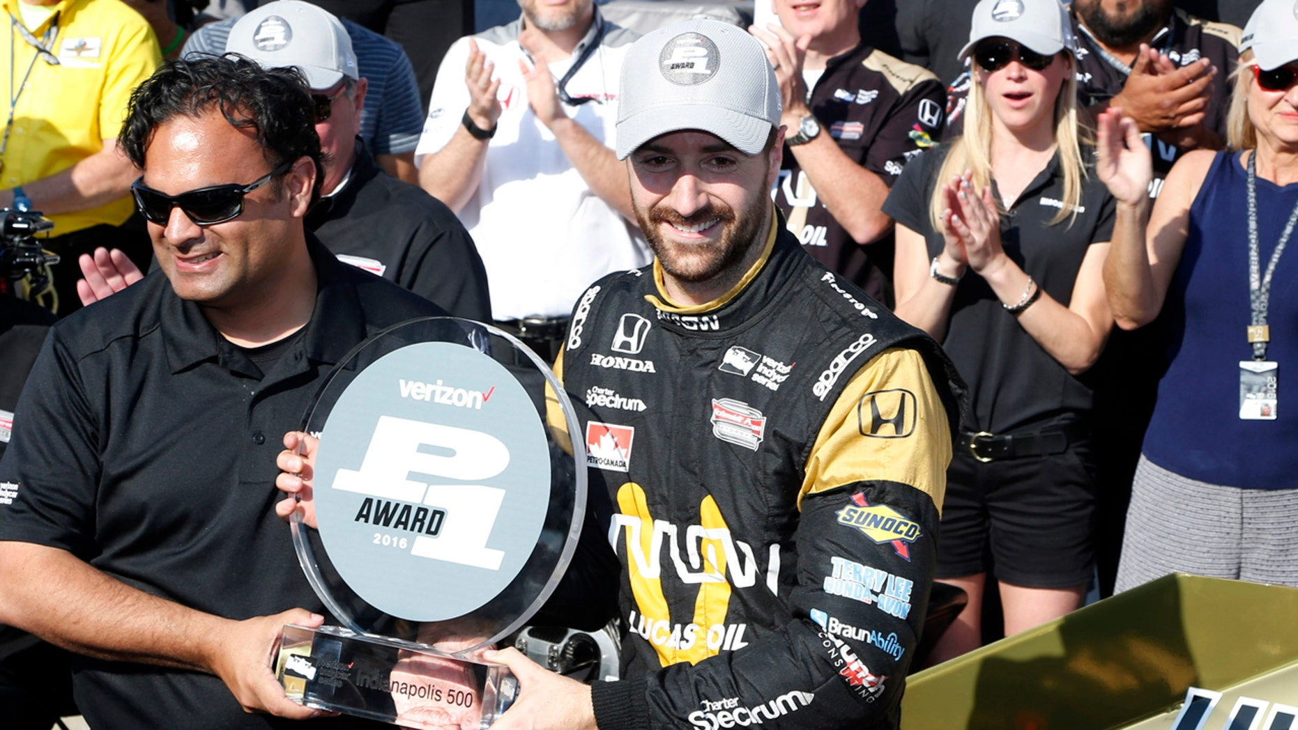 May 22, 2016; Indianapolis, IN, USA; Verizon Indy Car driver James Hinchcliffe accepts the pole award after winning the pole as the fastest qualifier during qualifications for the Indianapolis 500 at Indianapolis Motor Speedway. Mandatory Credit: Brian Spurlock-USA TODAY Sports - RTSFFWX