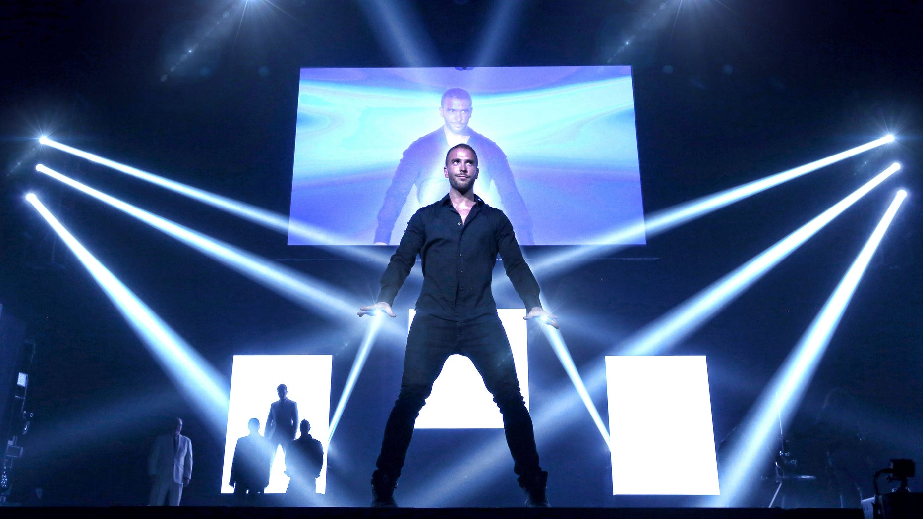 """James More, known as The Deceptionist, during a performance of """"The Illustionists - Live on Broadway."""""""